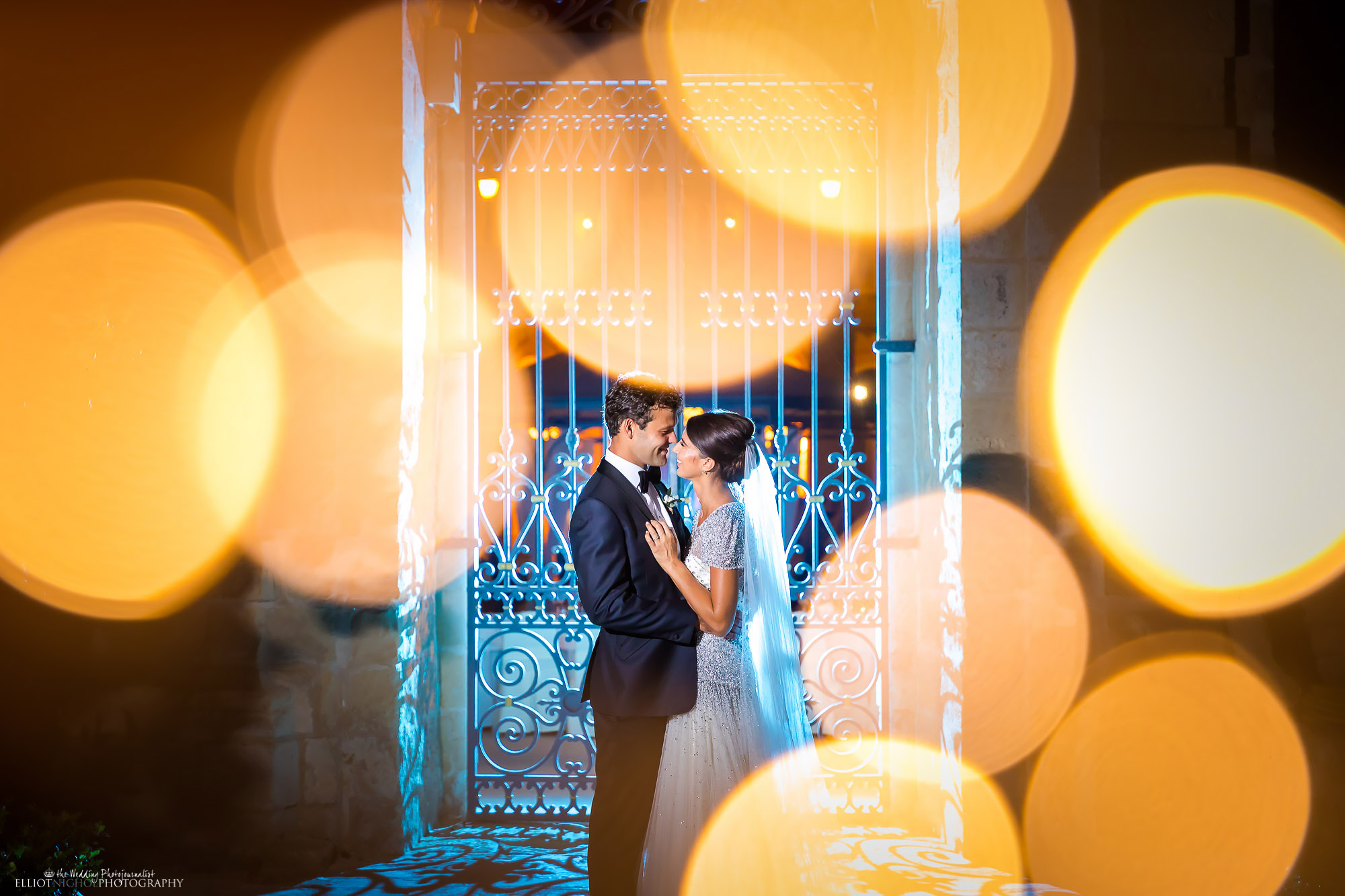 Bride and groom's portrait shot through fairy lights. Photo by North East based wedding photojournalist Elliot Nichol.