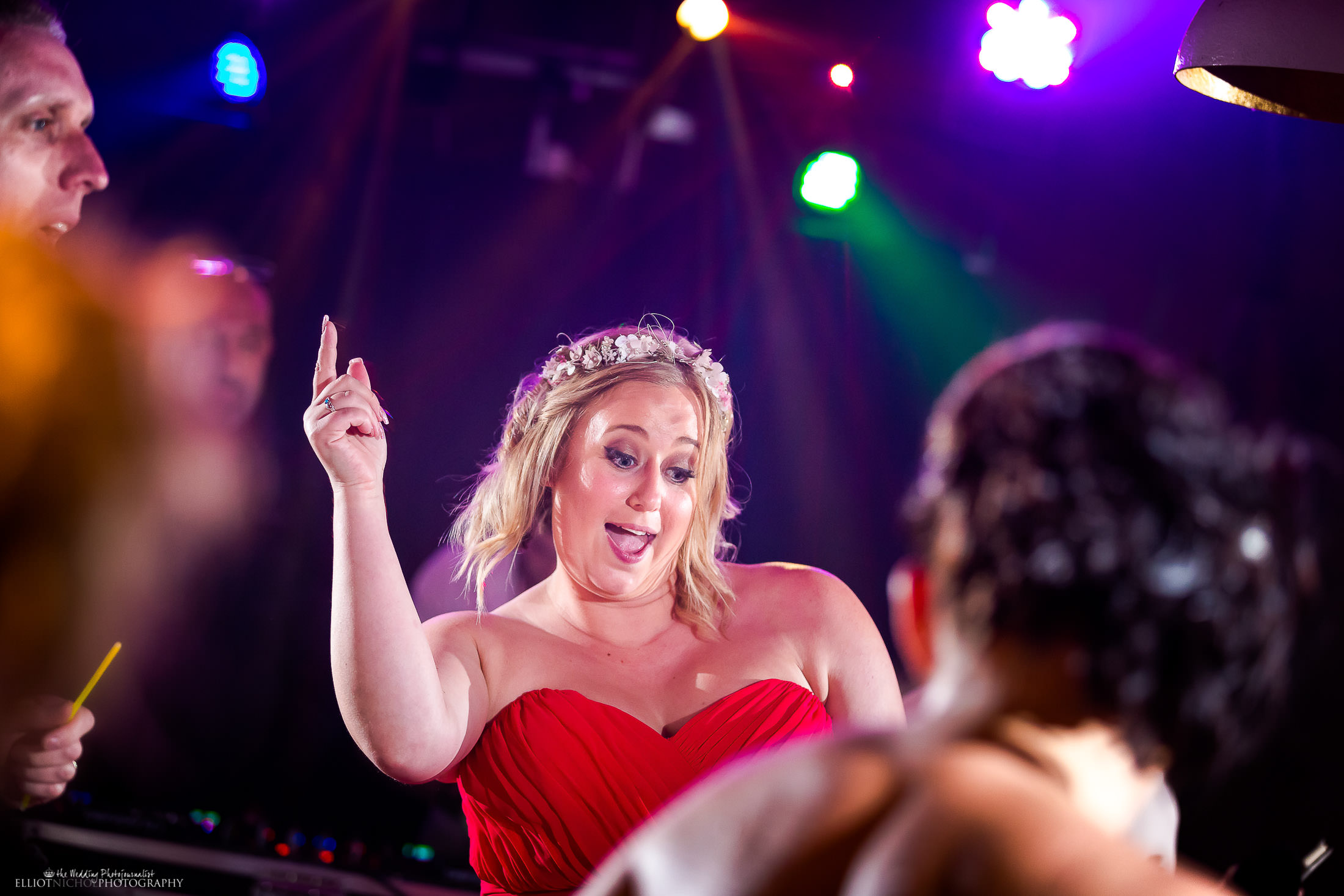 Bridesmaid partying hard on the dance floor. Photo by North East wedding photojournalist Elliot Nichol.