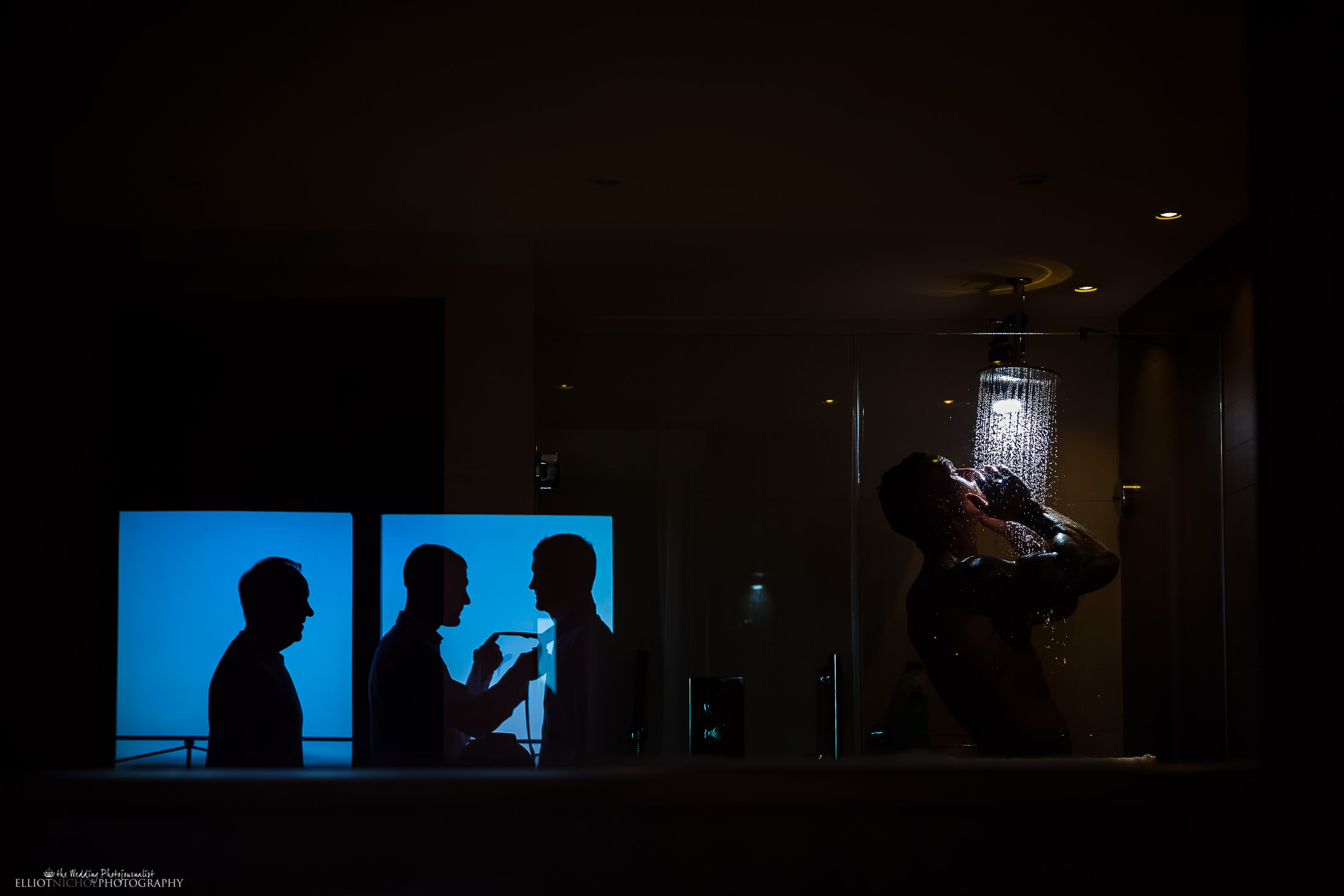 Groom takes shower while is groomsmen get ready. Photo by Newcastle Upon Tyne based wedding photographer Elliot Nichol, Photographing UK and EU destination weddings.