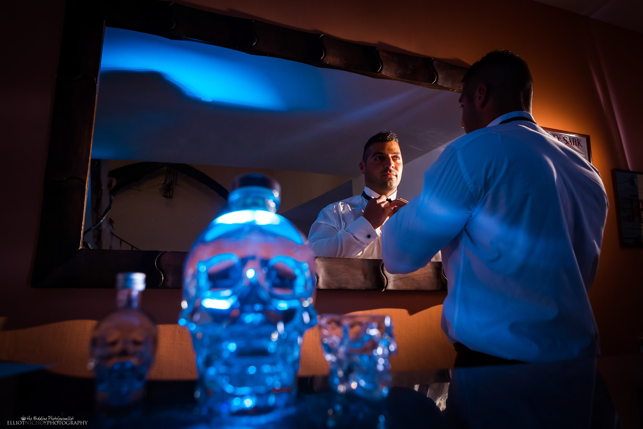 Groom getting ready. Photo by Elliot Nichol Photography.