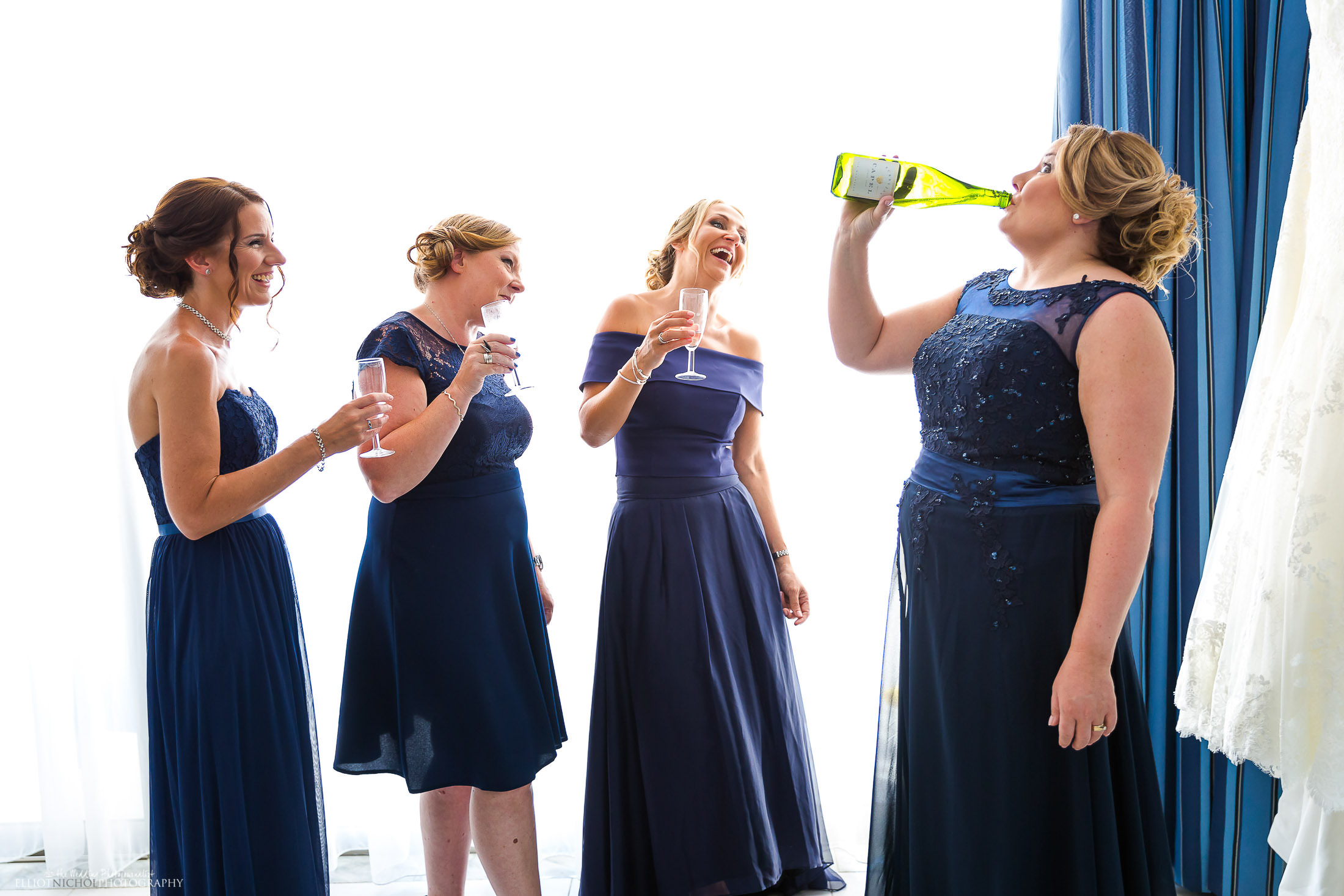 Bridesmaids have a little bit of dutch courage before leaving for the ceremony. Photo by Elliot Nichol Photography.