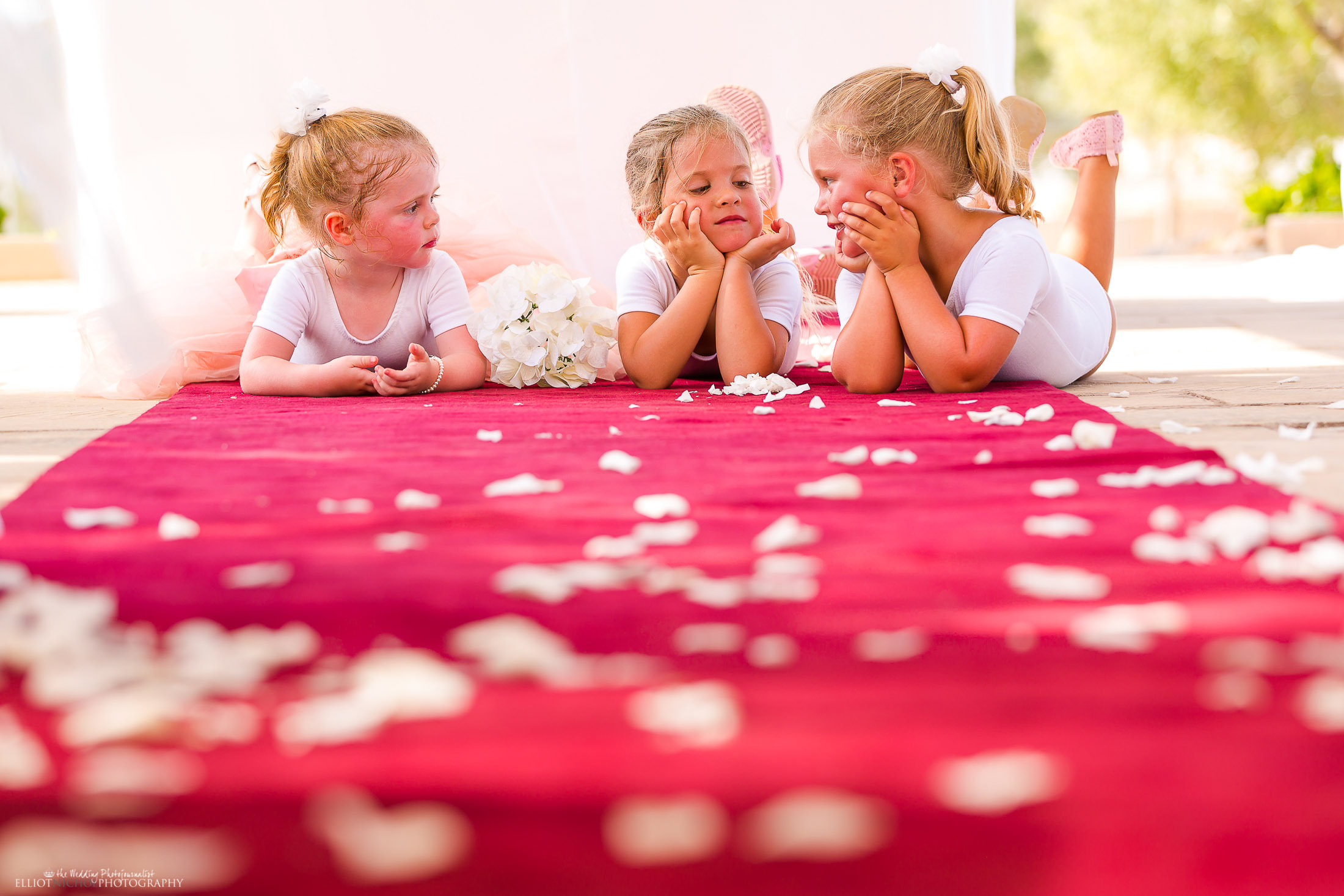Flower girls reflecting on their working roles during the ceremony. Photo by Elliot Nichol Photography.