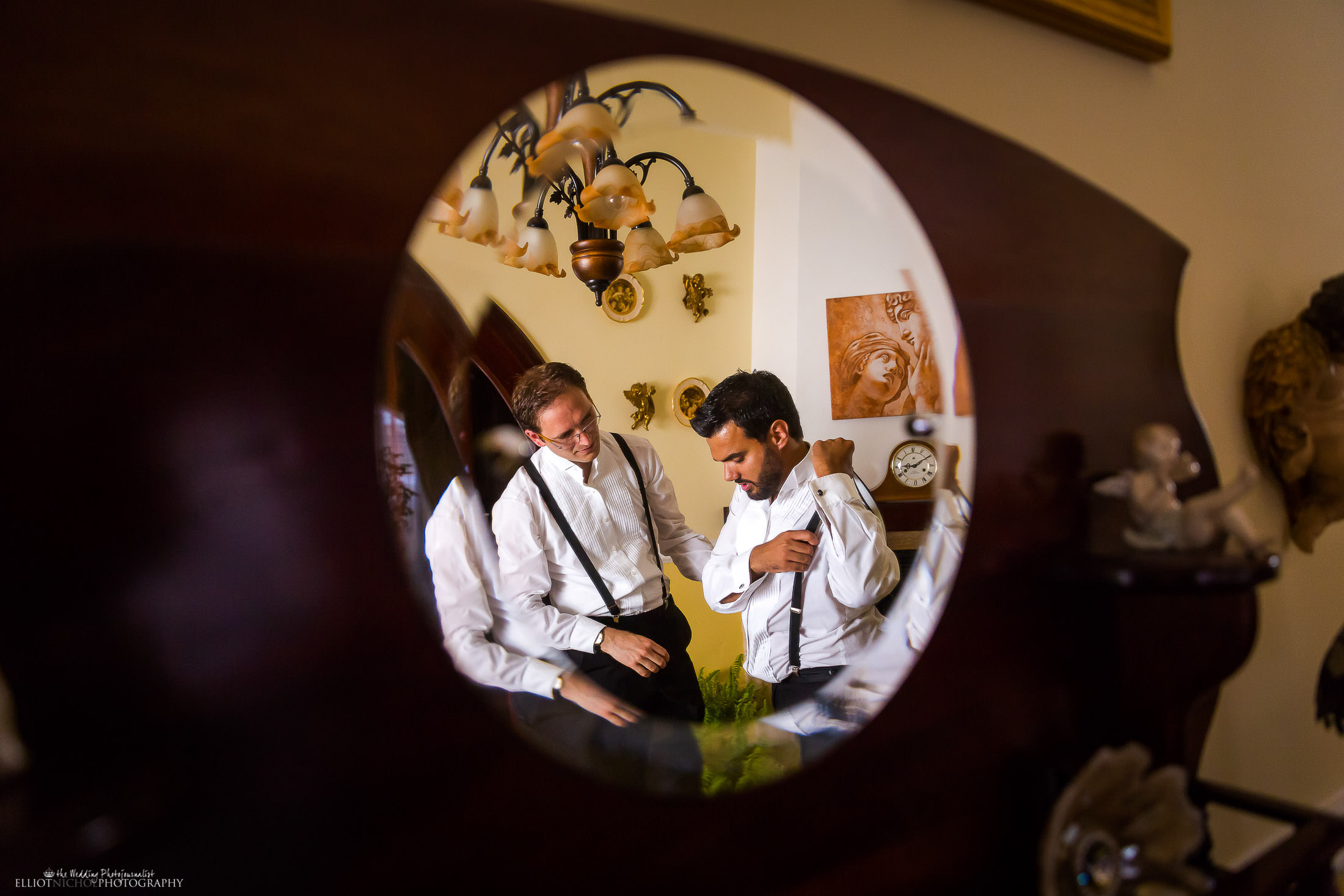 Groom getting ready with his best man. Wedding photojournalist Elliot Nichol based in Newcastle Upon Tyne and covering weddings across the UK and EU.