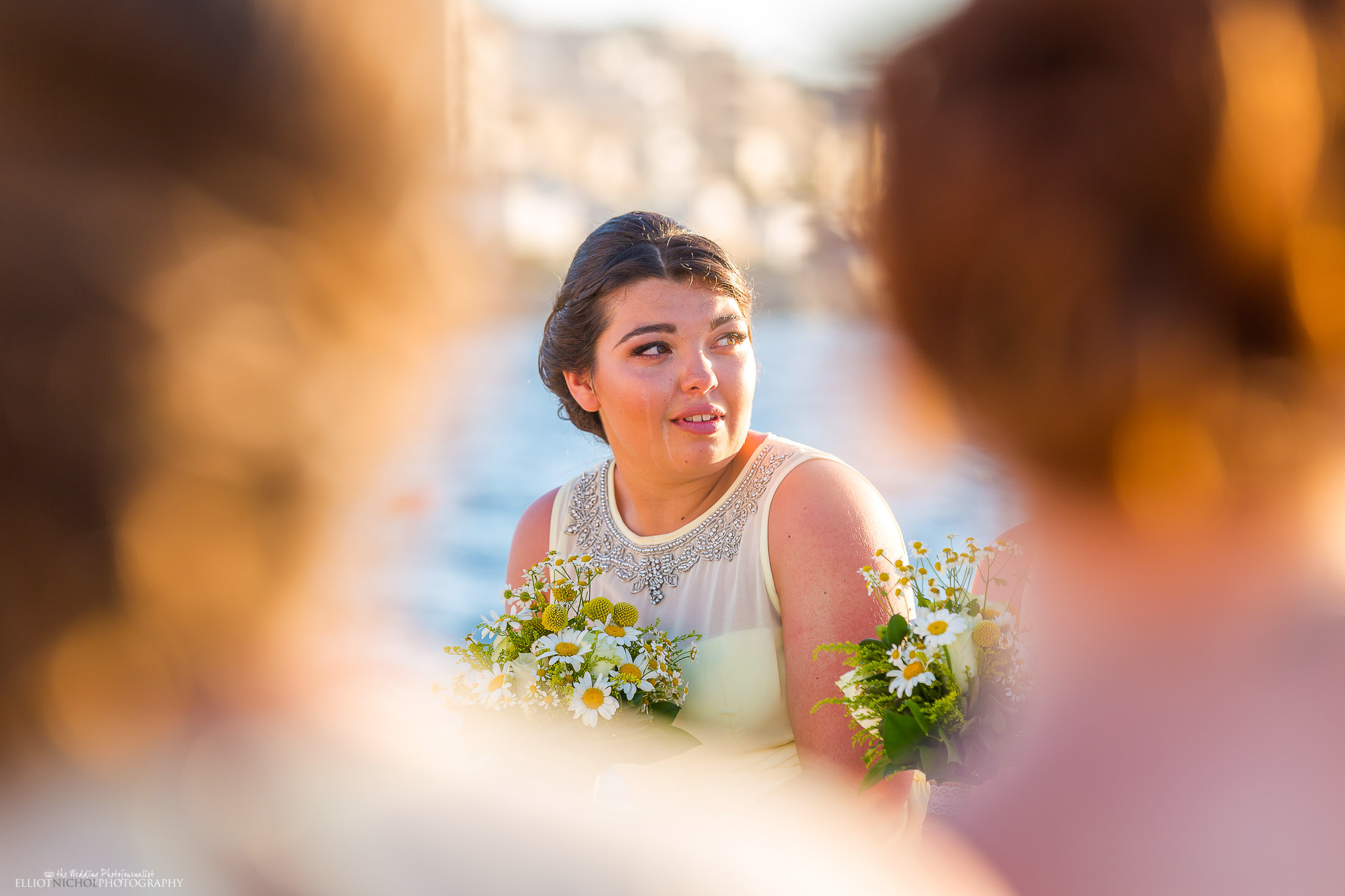 Emotional bridesmaid during the civil wedding ceremony. Photo by Elliot Nichol Photography.