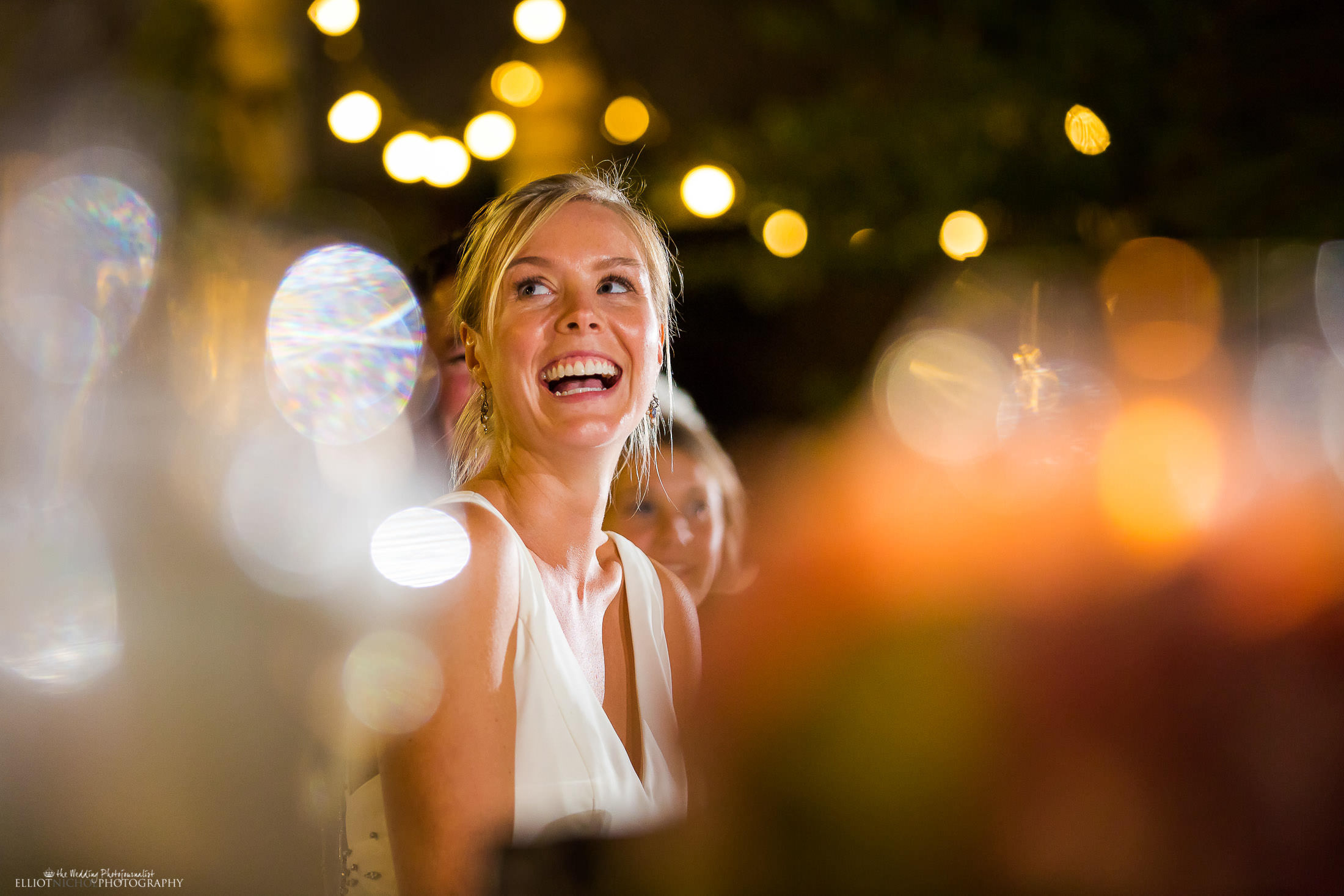 Brides reaction to her grooms wedding speech. Photo by North East wedding Photographer Elliot Nichol.