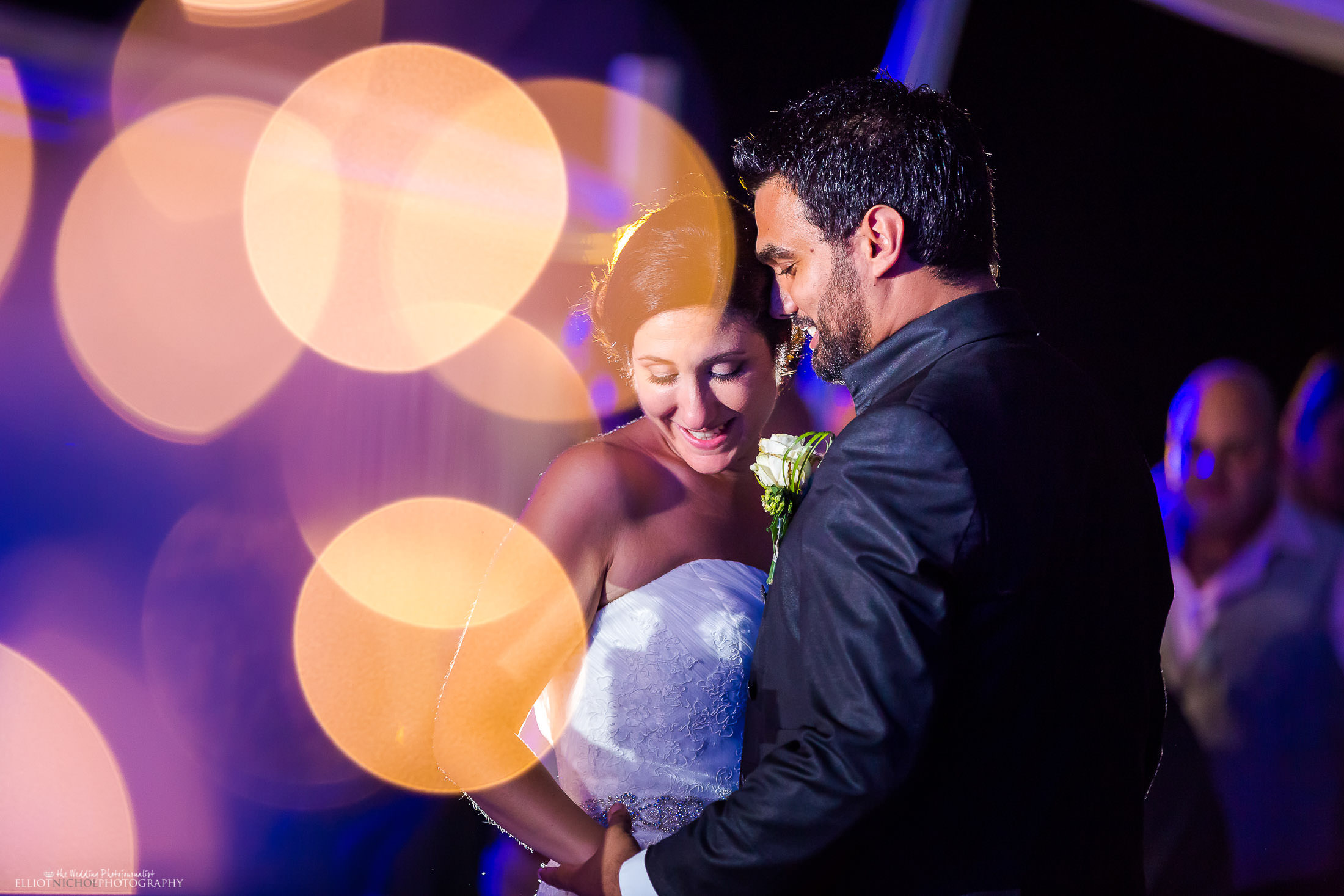 Bride and groom take their first dance together. Photo by Elliot Nichol Photography.