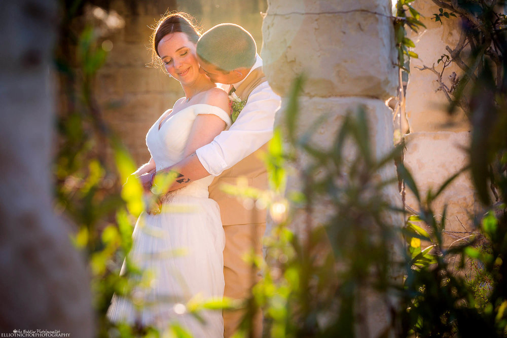 Bride and groom enjoying each others company in the gardens of their wedding venue. Natural wedding photography portraits of the newlyweds. Photo by Elliot Nichol Photography.