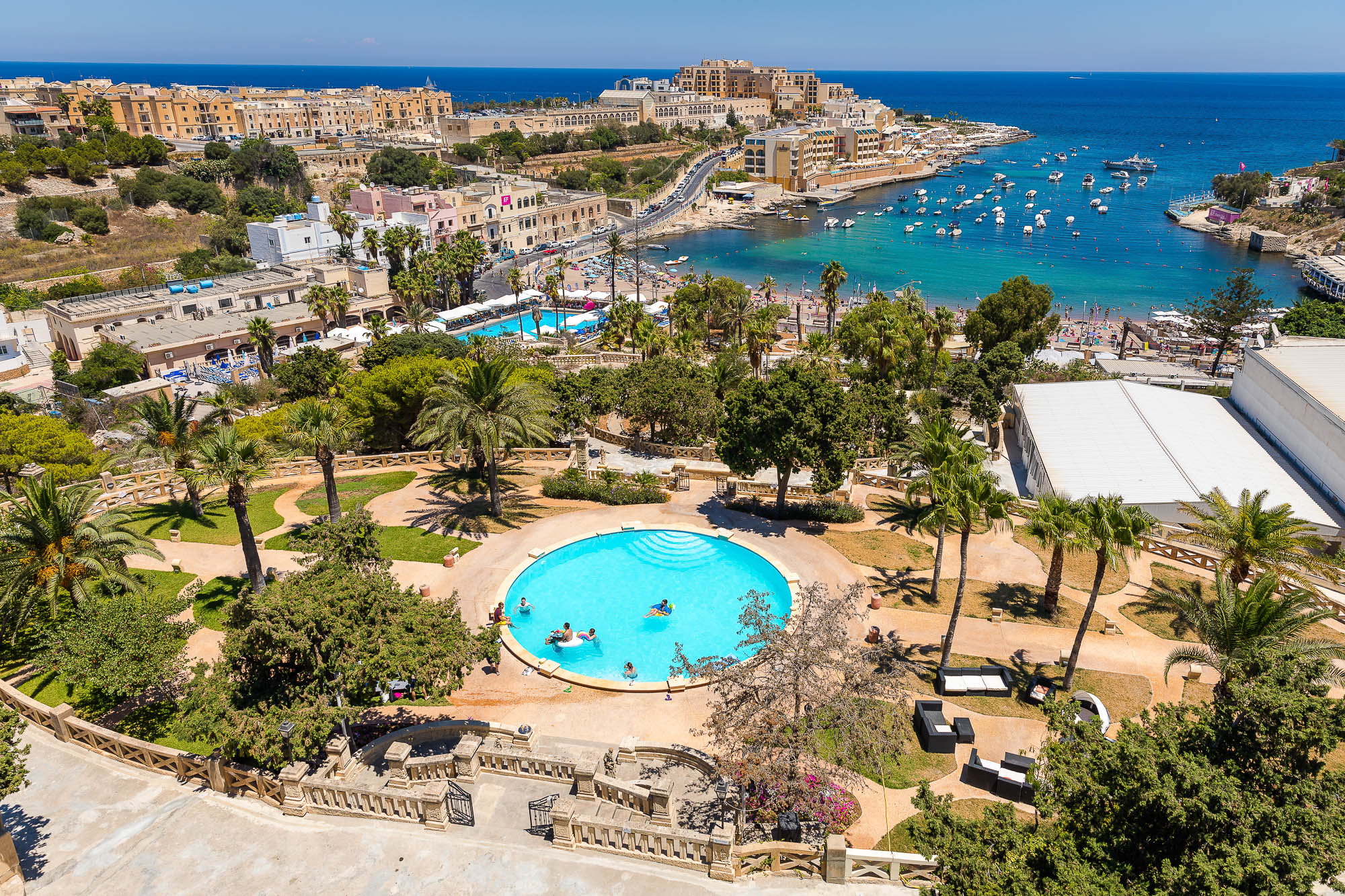View from Villa Rosa of it's gardens where wedding guests are staying for a UK destination wedding to Malta. Photo by Elliot Nichol Photography