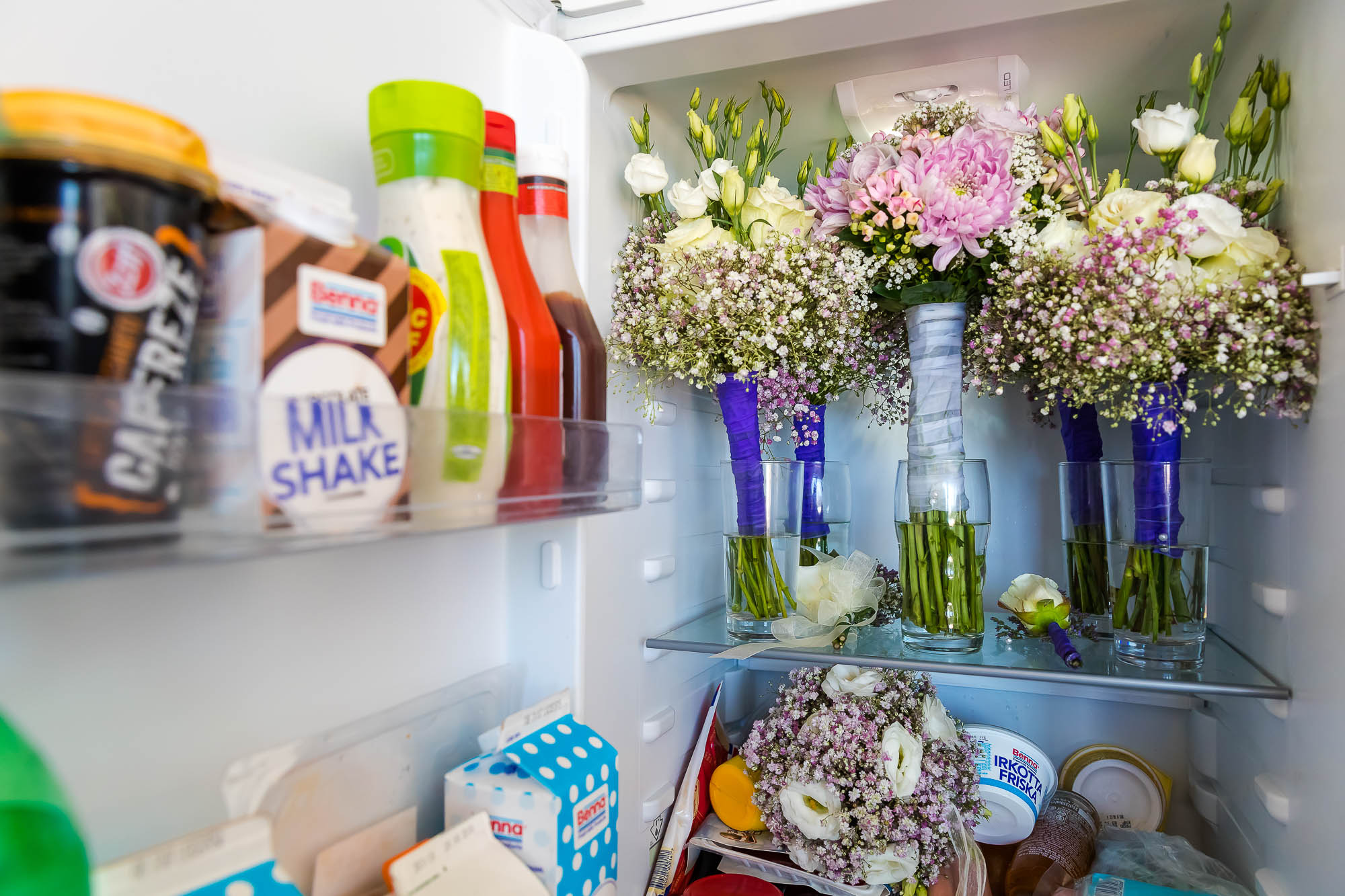 Bridal wedding day flowers in the fridge. Photo by Elliot Nichol Photography.
