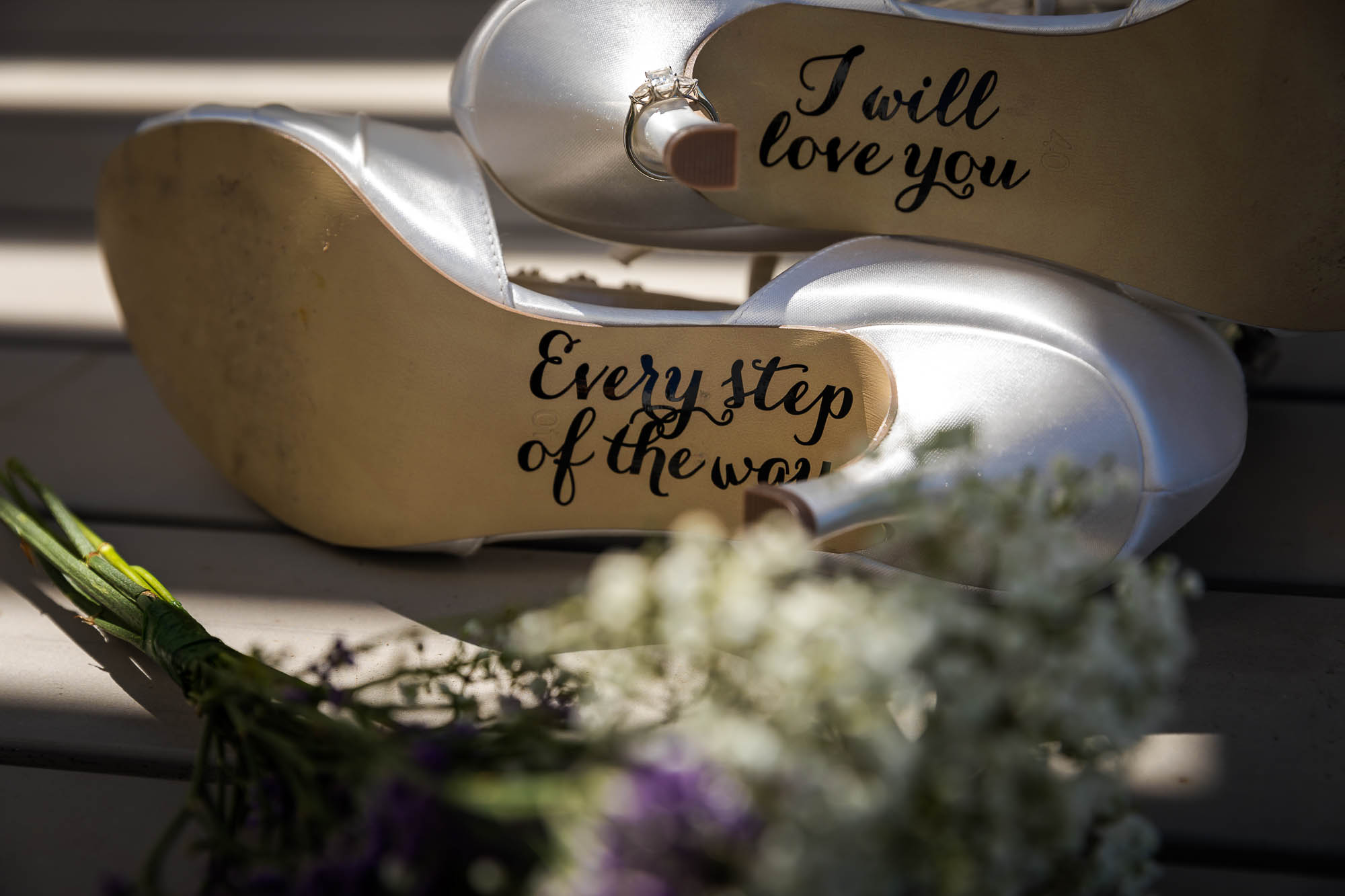 Writing of the soles for the brides wedding shoes. Photo by Elliot Nichol Photography.