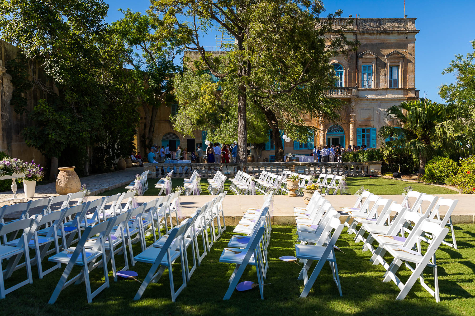 Civil ceremony setup in the baroque garden of Villa Bologna in Malta. Photo by Elliot Nichol Photography.