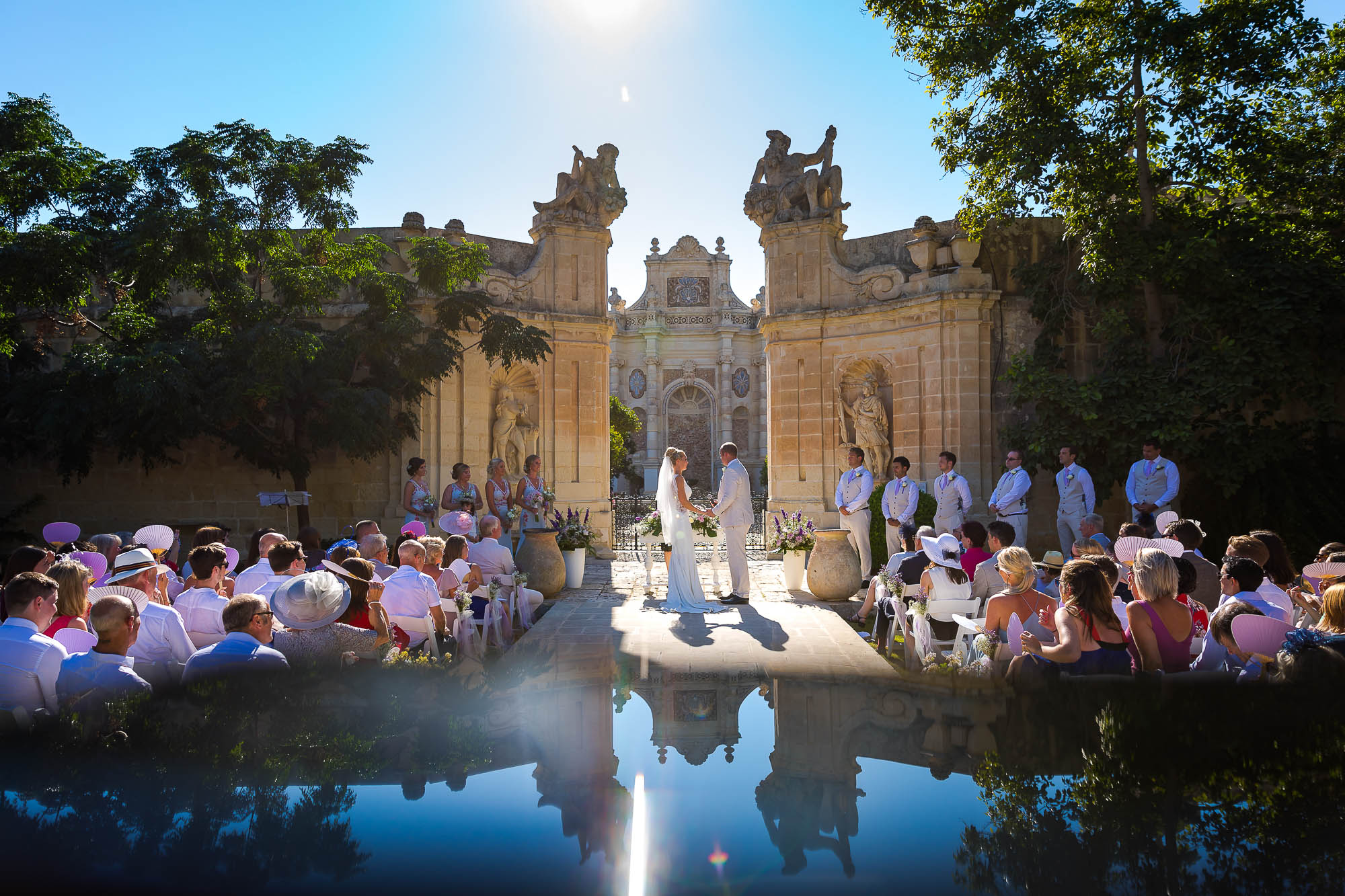 Creative wedding ceremony photograph using a reflection on a iPhone. Photo by Elliot Nichol Photography.