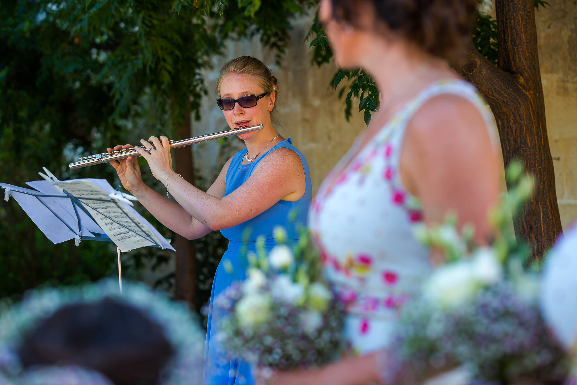 Wedding musician plays the flute during the wedding ceremony. Photo by Elliot Nichol Photography