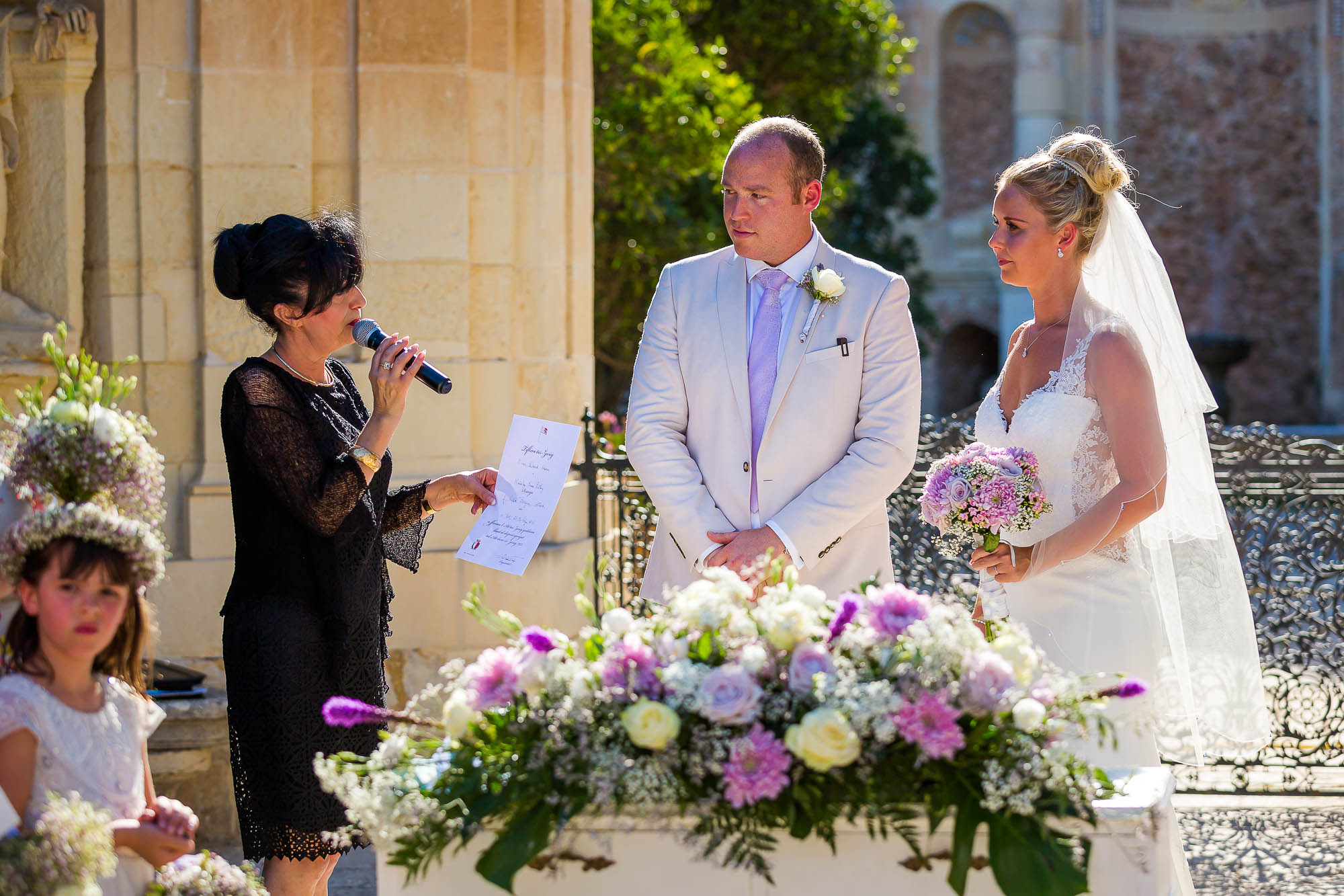 Bride and groom receive a temp wedding certificate for the wedding registrar. Photo by Elliot Nichol photography.