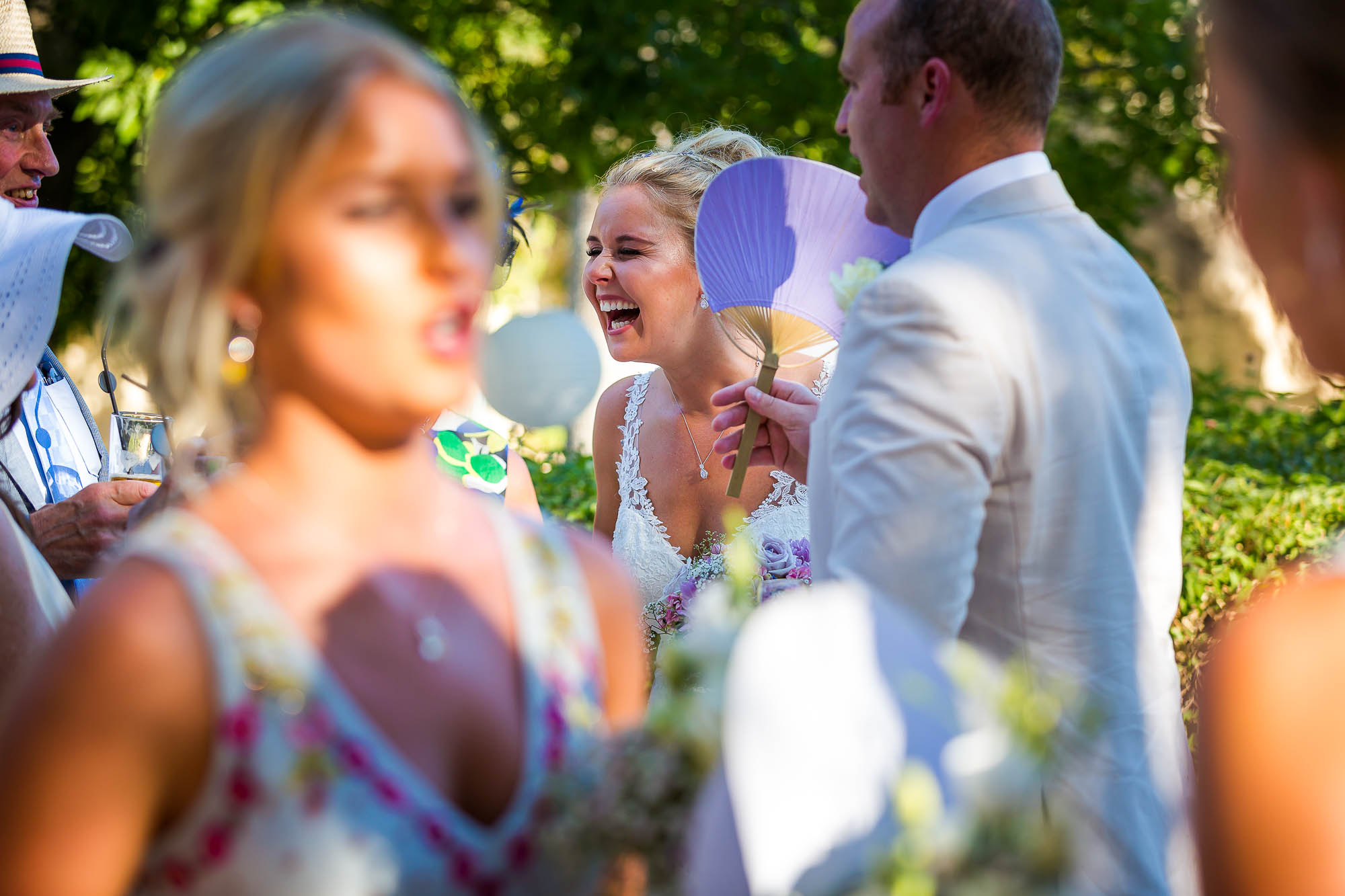 Candid photo of the bride laughing. Photo by Elliot Nichol Photography