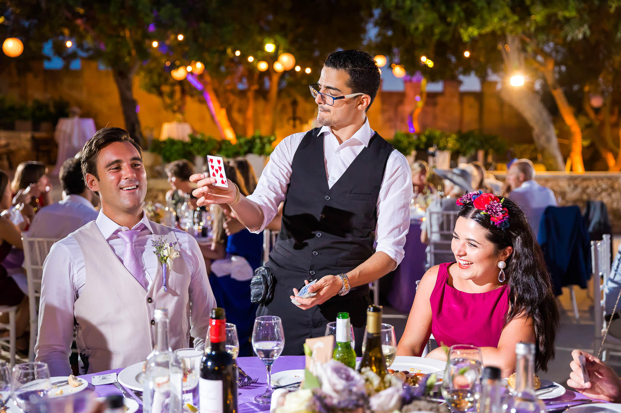 Wedding reception magic with a magician. Photo by Elliot Nichol Photography.
