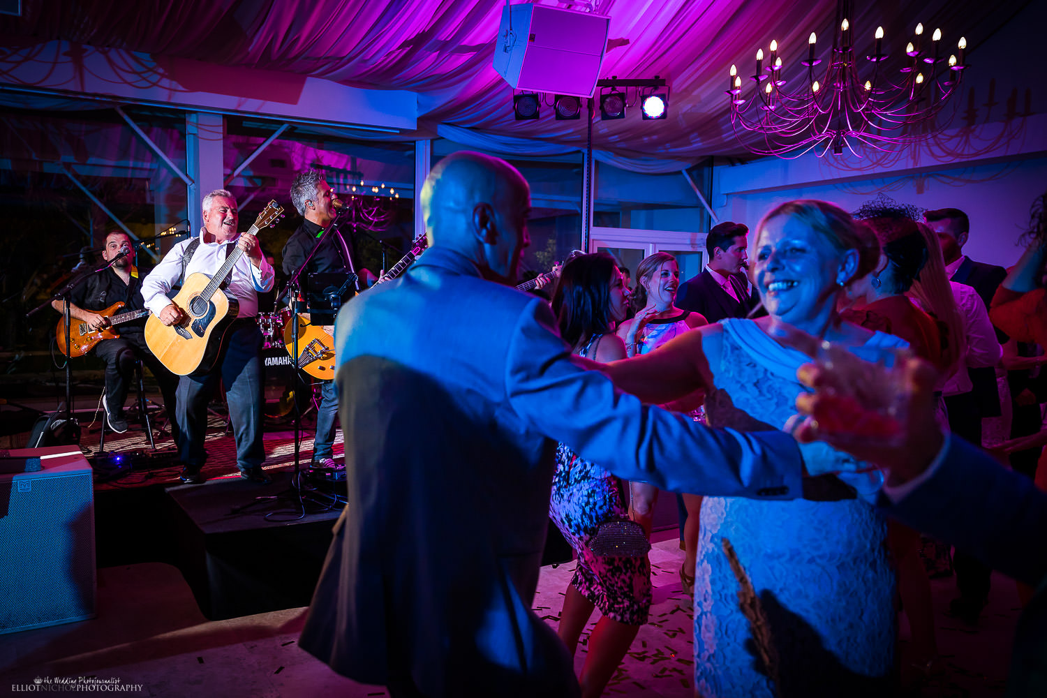 Fun wedding guest decides to take to the stage to entertain the wedding reception. Wedding photography by North East wedding photojournalist Elliot Nichol.