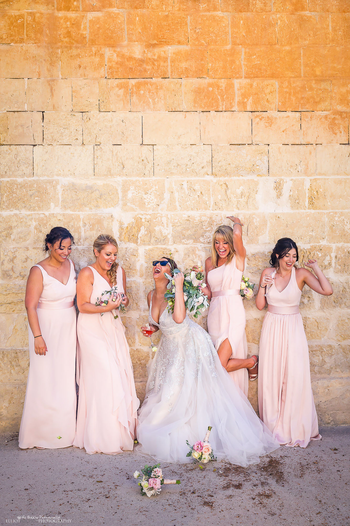 Bride and her Bridesmaids having fun during the wedding group-shots. Wedding photojournalist Elliot Nichol.