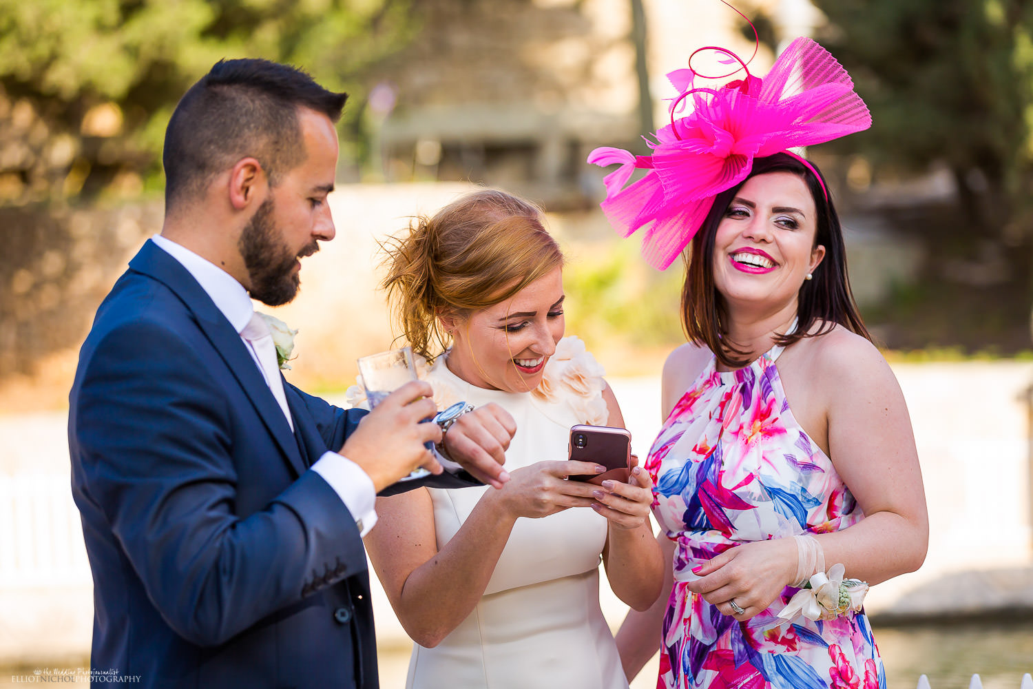 Candid photo of wedding guests enjoying the wedding day. Photo by Elliot Nichol Photography.