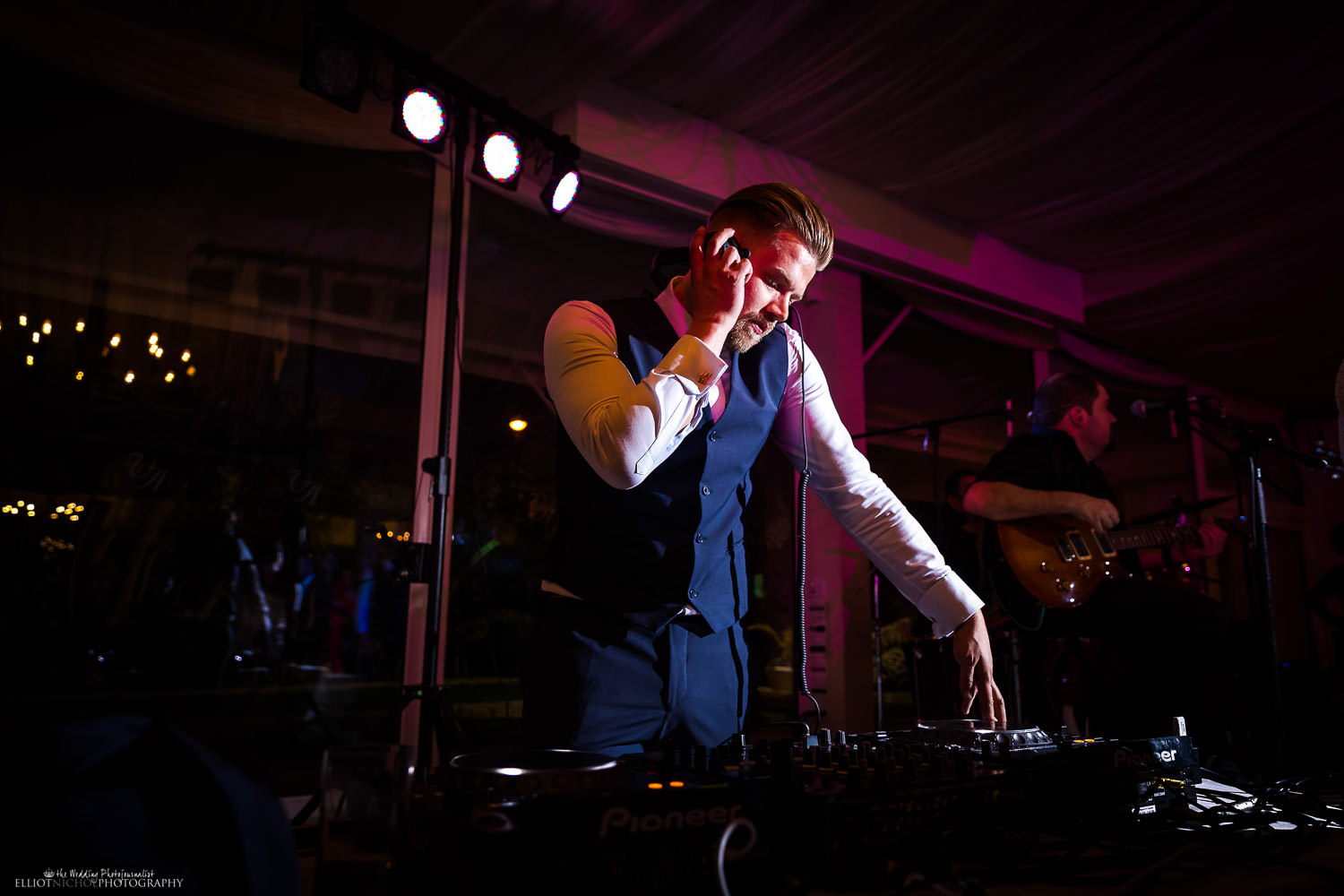 Wedding guest turns DJ during the wedding reception. Photo by Newcastle Upon Tyne based wedding photographer Elliot Nichol.
