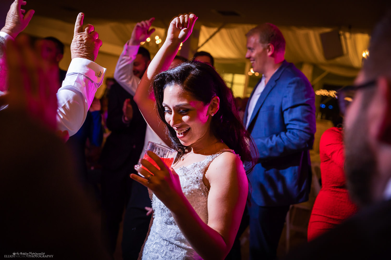 Bride dancing on the dance floor during her wedding reception. Photo by Elliot Nichol Photography.