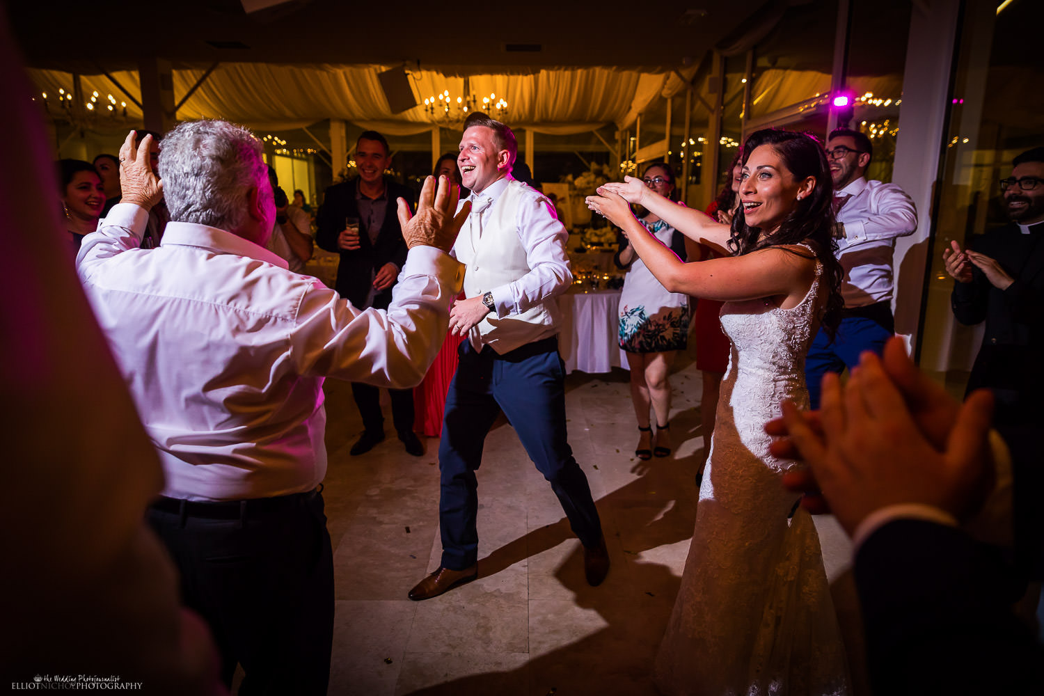 Bride and groom on the dance floor at their destination wedding reception. Photo by Elliot Nichol Photography.