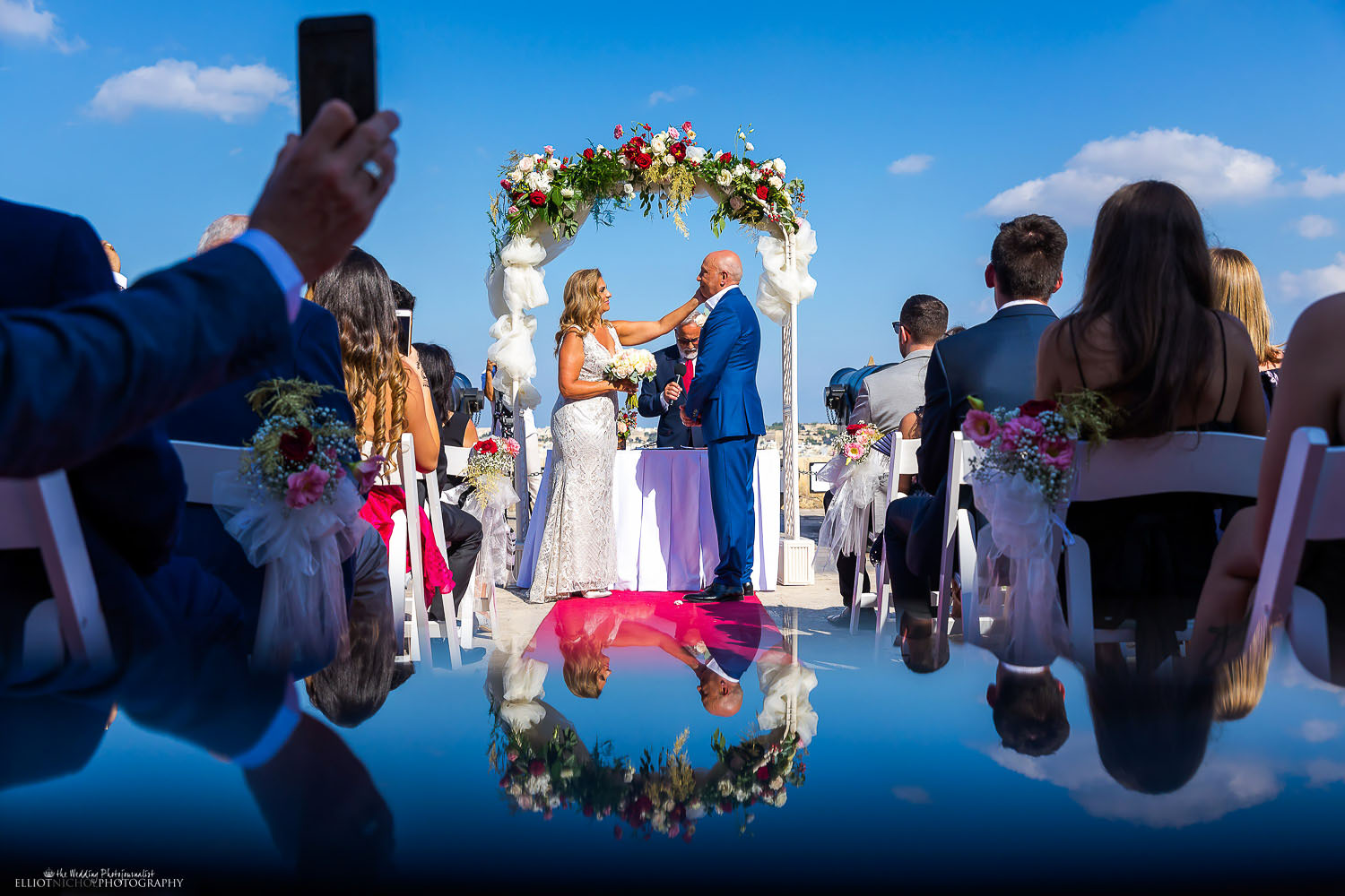 Mature couple say their vows during an outdoor civil ceremony.Photo by North East based wedding Photographer Elliot Nichol. Capturing weddings throughout the UK and the EU.