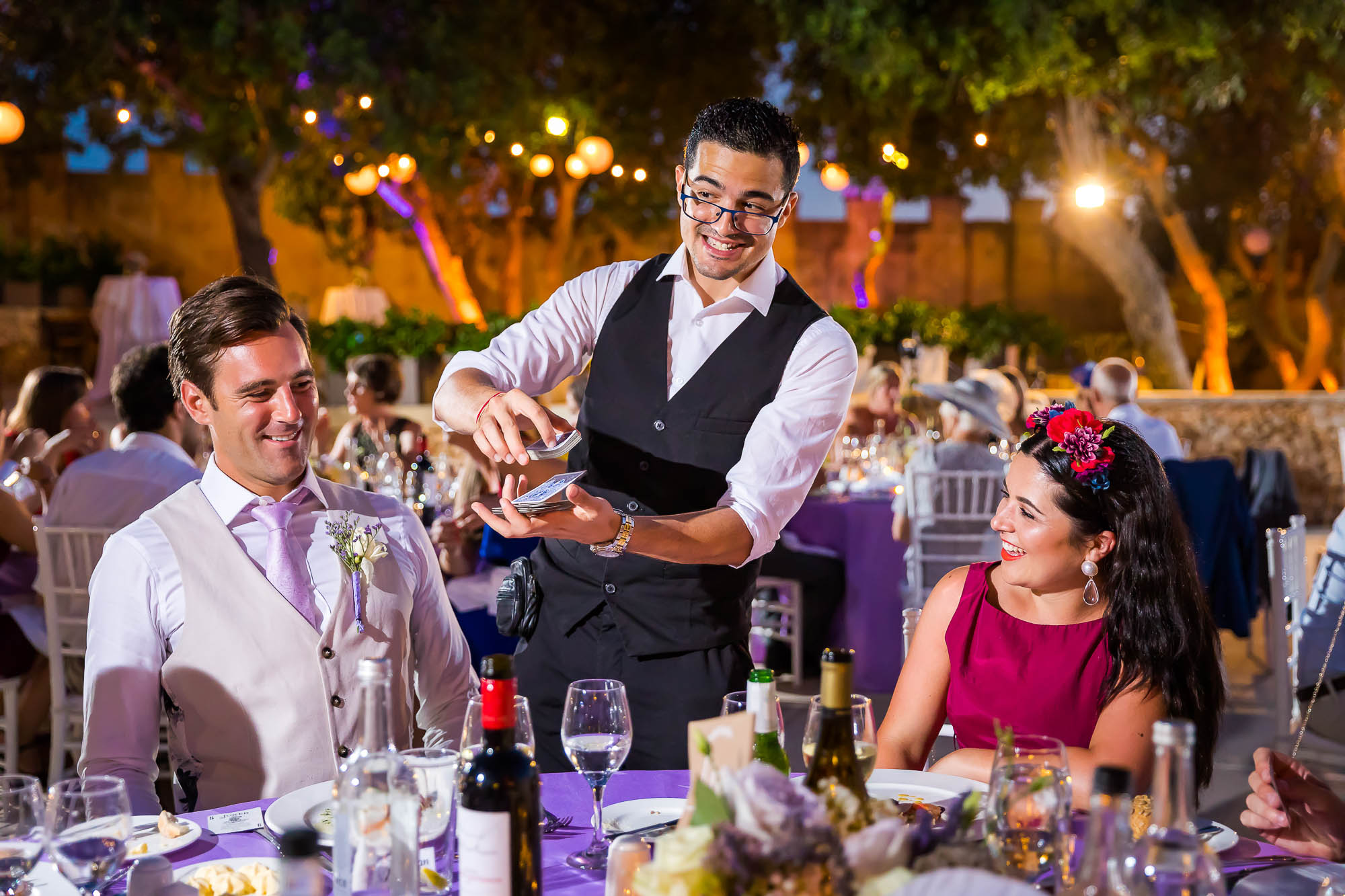 Wedding magician working his magic with the wedding guests during the wedding reception. Photo by Newcastle Upon Tyne based wedding photographer Elliot Nichol.