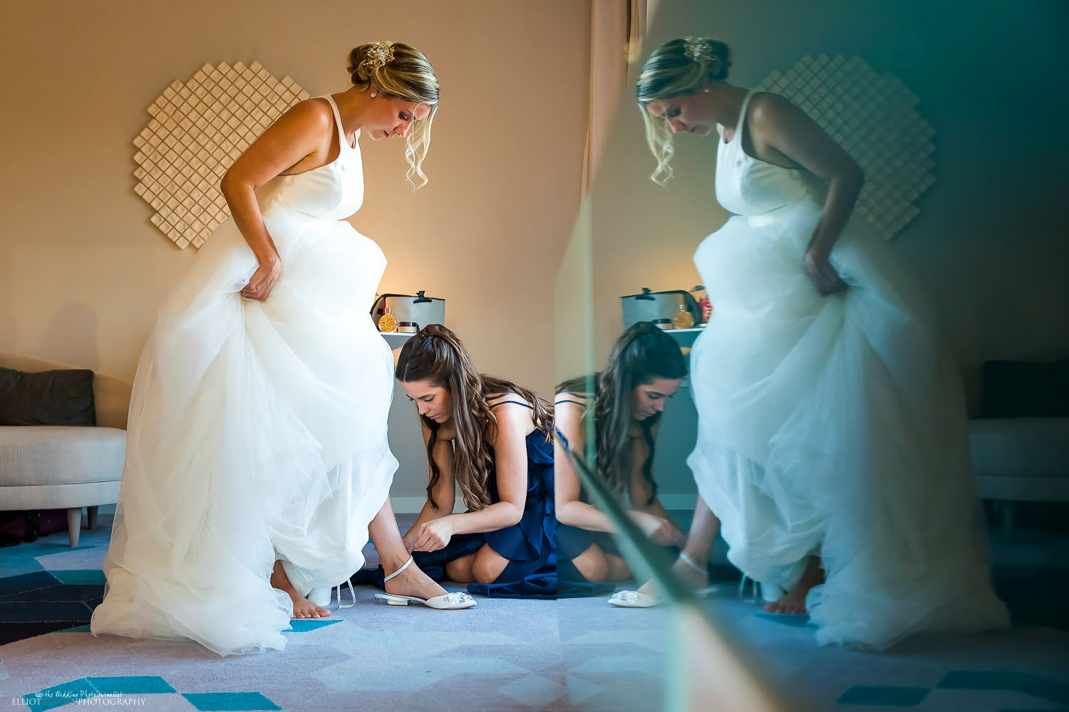 Bride getting ready with the help of her Bridesmaid. Photo by Elliot Nichol Photography.