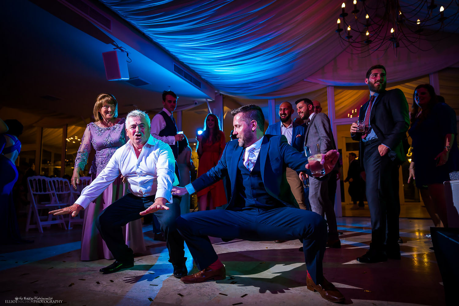 Wedding guests having a dance off during the wedding reception party. Photo by Elliot Nichol Photography