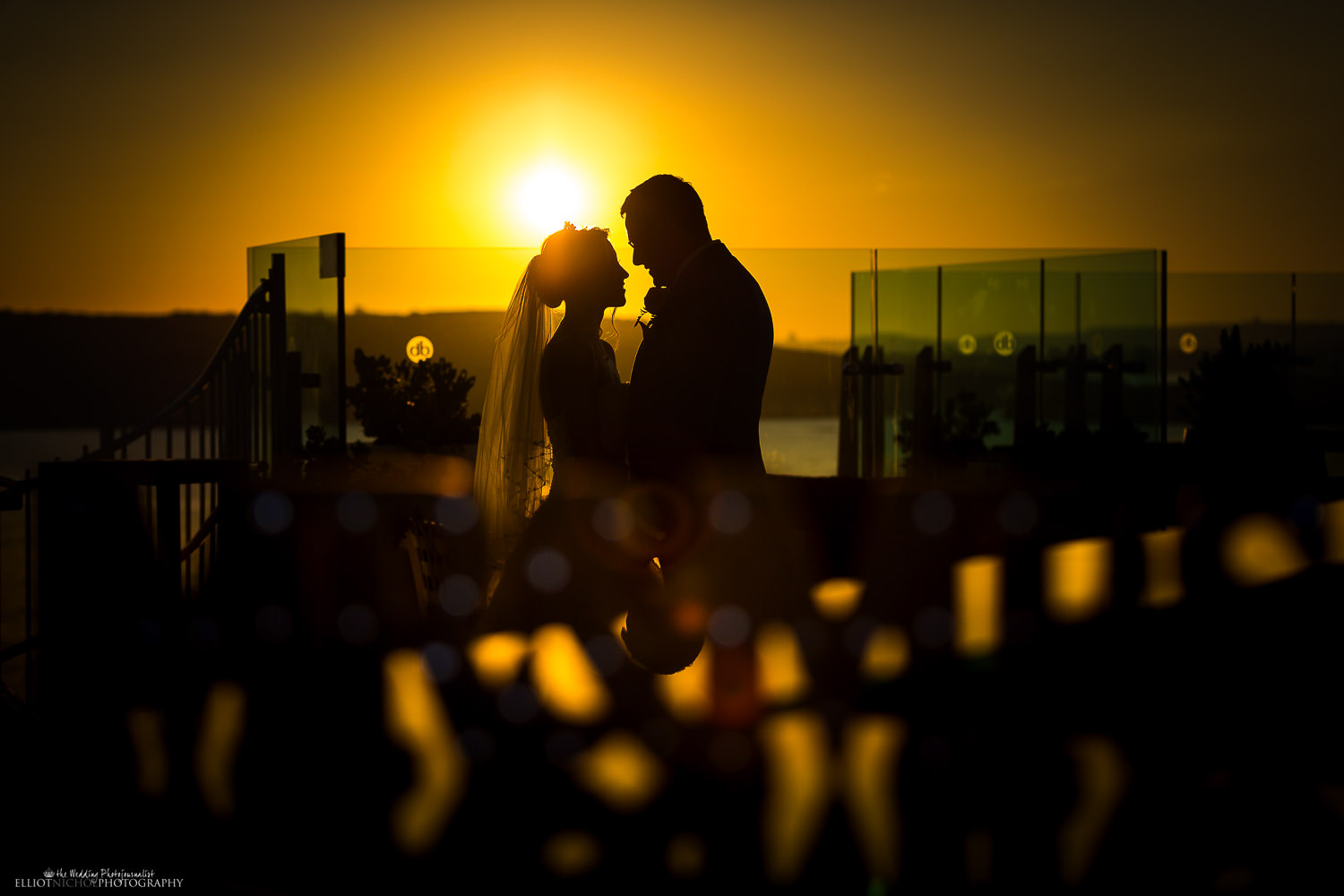 Silhouette of the bride and groom during sunset. Photo by Elliot Nichol Photography.