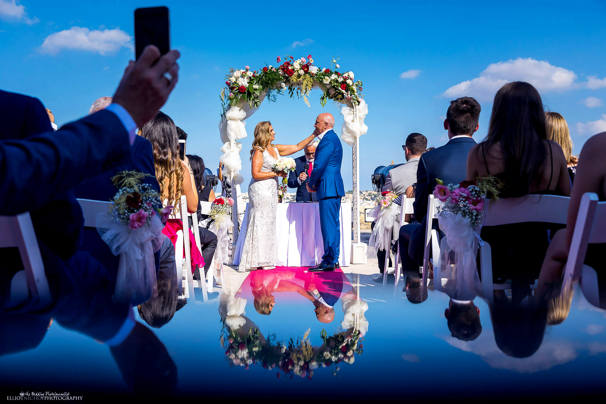 Couple from Northumberland say their vows during a garden civil wedding ceremony. Photo by North East based photographer Elliot Nichol Photography