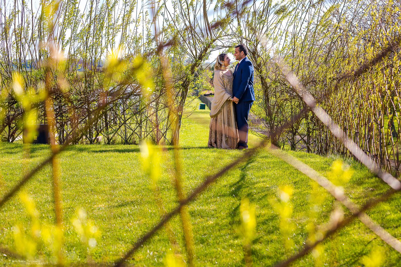 Asian couple in the grounds of Vallum Farm, Newcastle Upon Tyne. North East wedding photographer Elliot Nichol.
