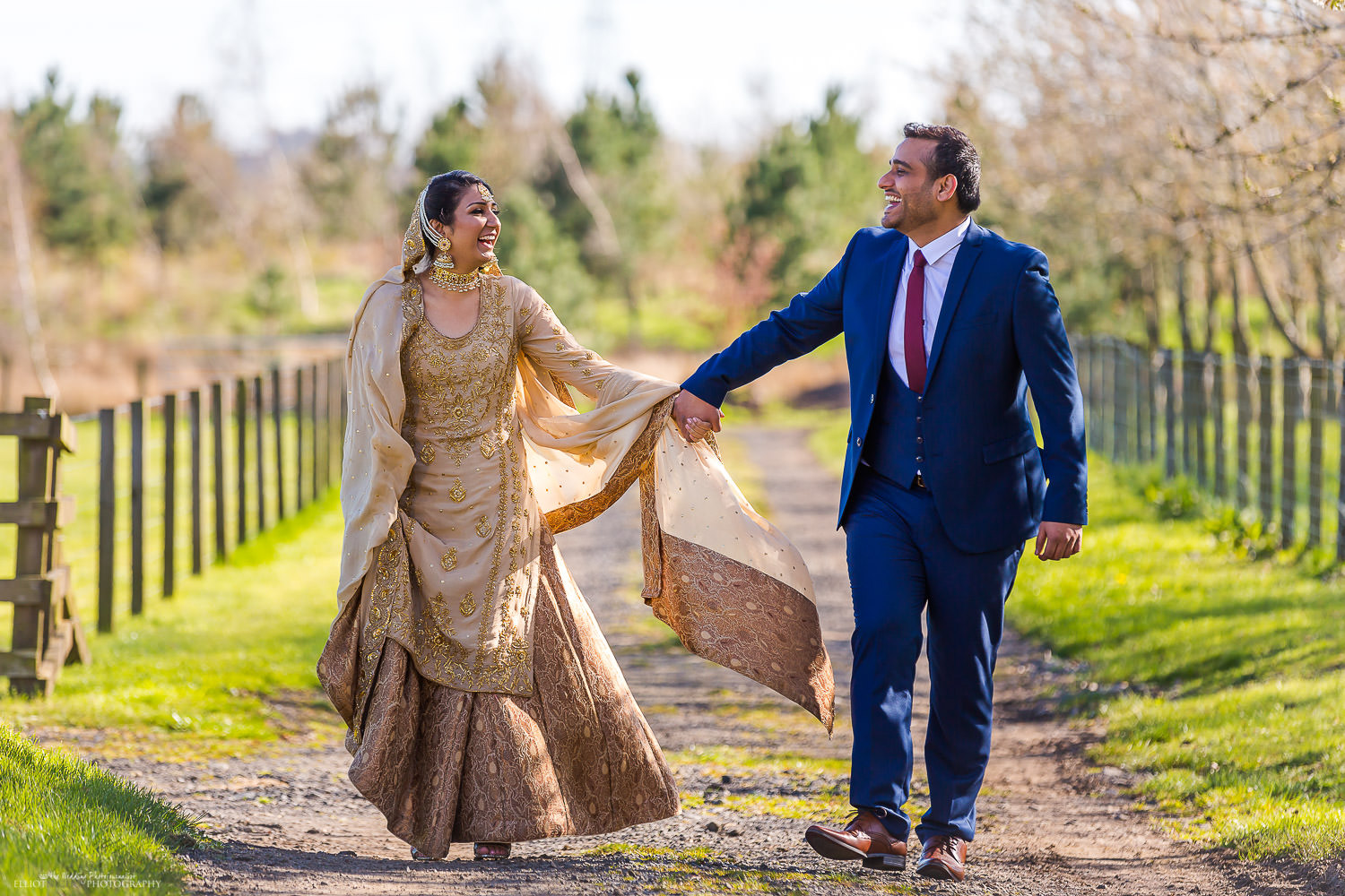 Asian couple having fun whilst walking through the Vallum Farm grounds. North East wedding and engagement photographer - Elliot Nichol Photography.