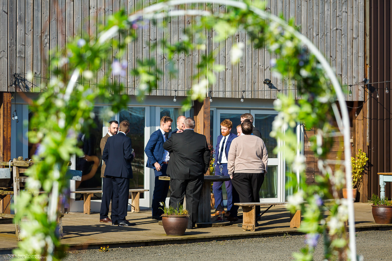 Guests enjoying some drinks before the asian engagement ceremony at Vallum Farm. Newcastle wedding photographer Elliot Nichol.