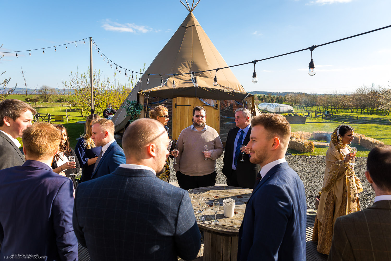 Engagement party at Vallum farm. Guests having drinks next to the Tipi. Photo by Elliot Nichol Photography.
