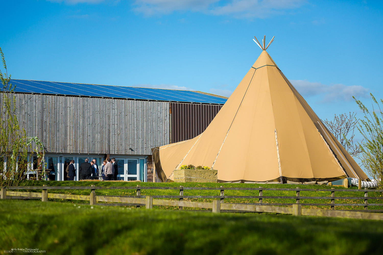 Guests next to Tipi at Vallum Farm, Newcastle Upon Tyne. Photo credit to Elliot Nichol Photography.