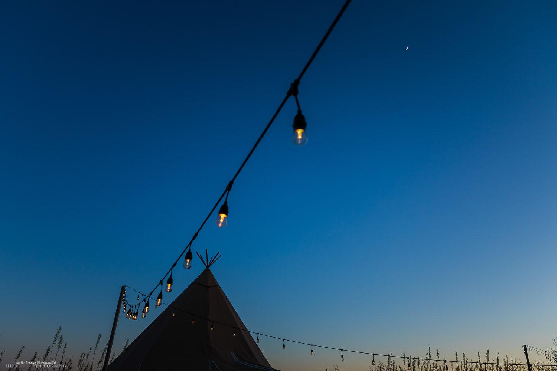 Vallum Farm's Tipi and lights during twilight. Photo by Newcastle Upon Tyne's wedding photographer Elliot Nichol Photography.