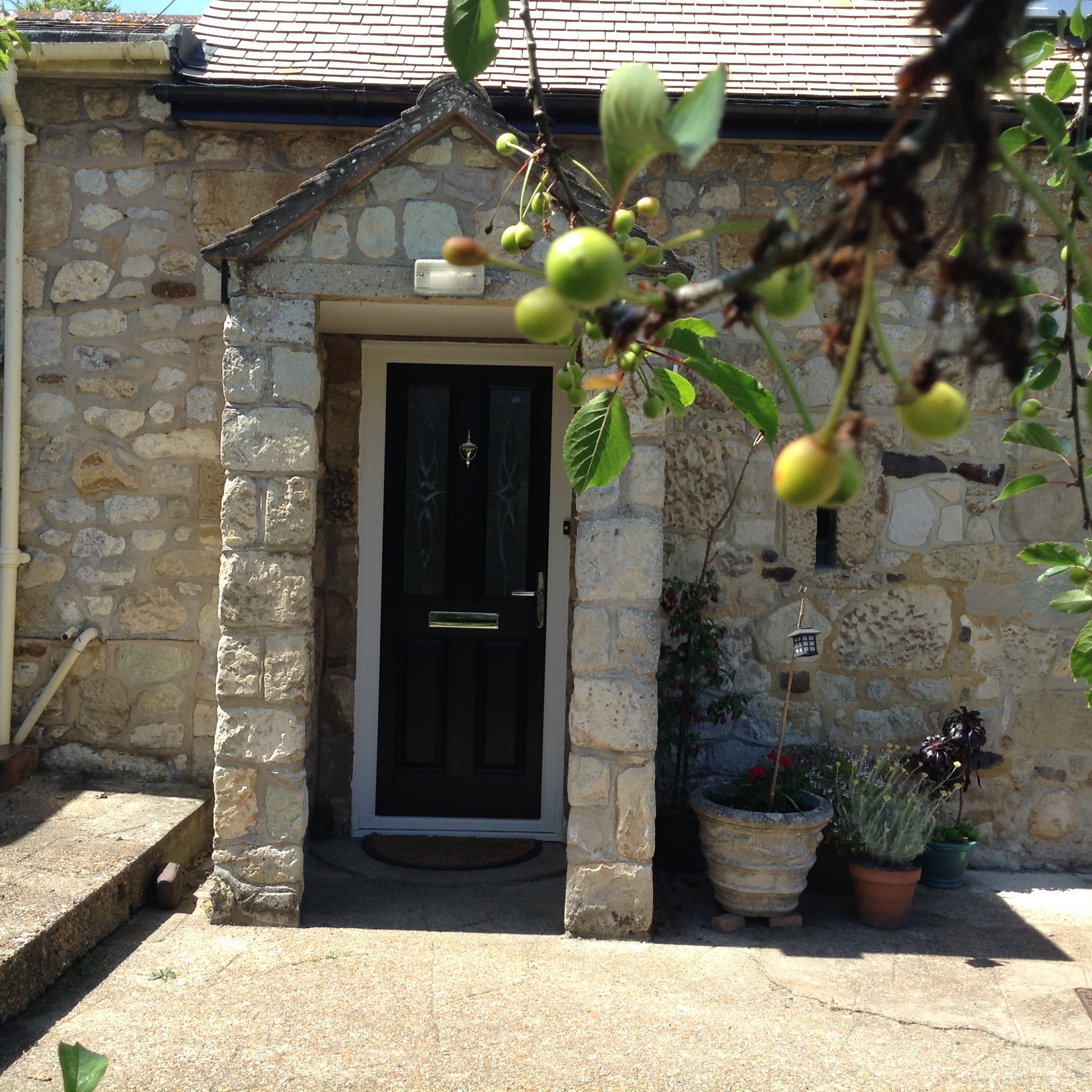 The front door to the house with it's beautiful characterful stone.