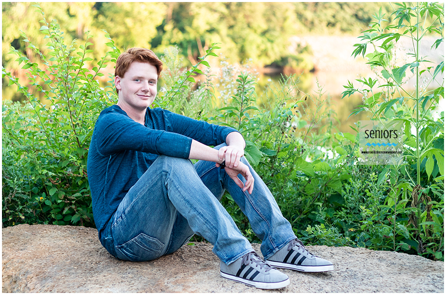 senior urban pictures in downtown elk river minnesota on the mississippi river
