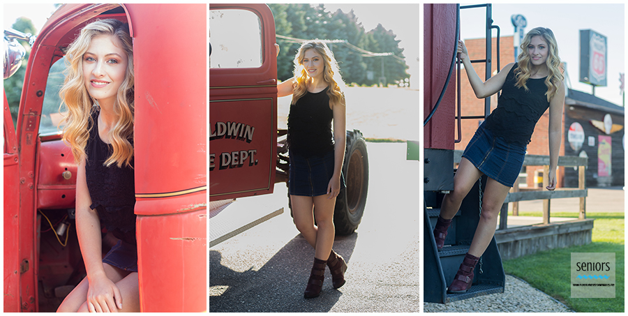 A St. Michael Albertville senior girl having her senior pictures taken on a train and fire truck at the Little Log House Pioneer Village in Hastings, Minnesota.