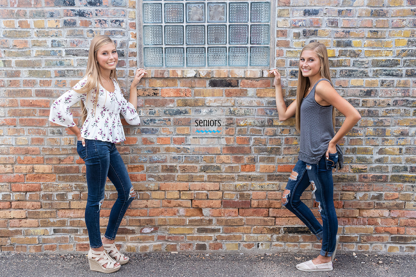 Twin high school senior girls getting their senior pictures taken in downtown Anoka, Minnesota.
