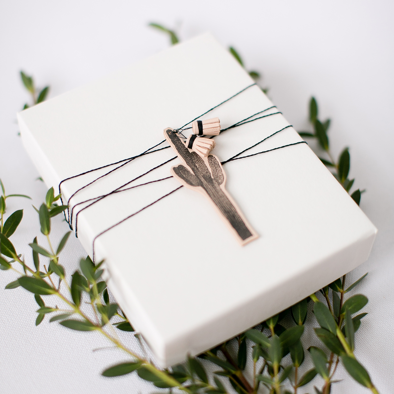 DIY Stamped Gift Wrap with Leather Tassel | Akula Kreative | Photo by Kimberly Chau