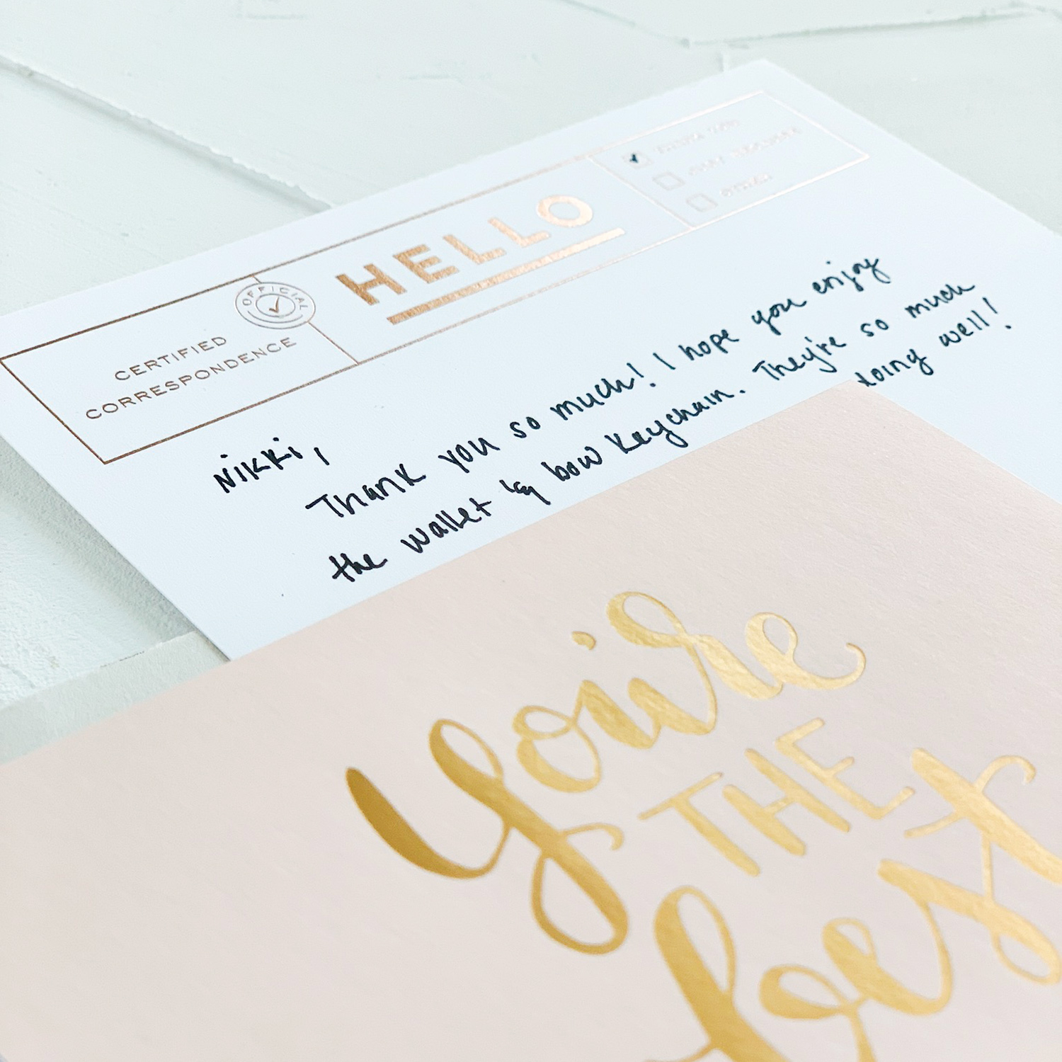 Paper on My Desk, a new mini series by Akula Kreative | Gold foil-stamped stationery, gray envelope with white wax seal, black sticker, rose gold foil-stamped stationery card, vintage stamp in gold and blush