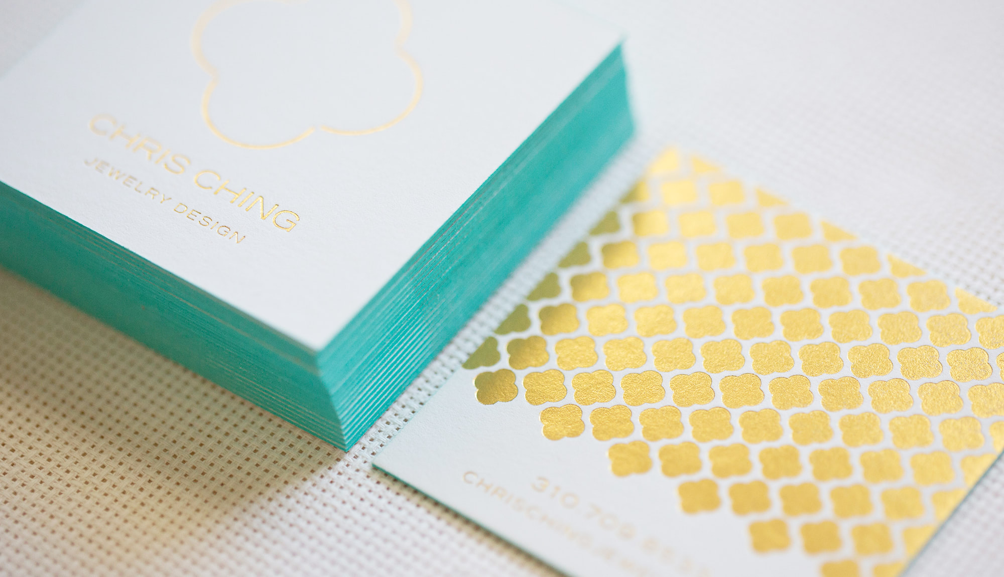 Gold Foil-Stamped Business Card with Aqua Edges | Akula Kreative | Houston, TX