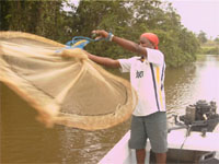 A youth collecting samples of the lagoon for his study.