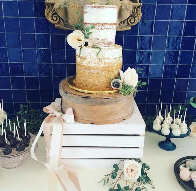 Two tier Poppin Bottles cake.jpg