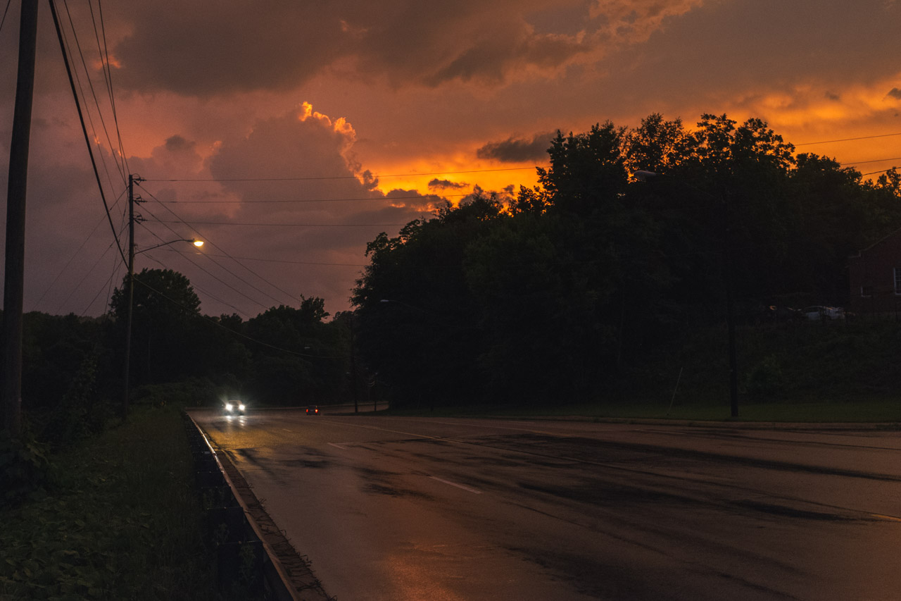 I was on the phone with a friend when I turned this curve and just got struck by the beauty of the light. I abruptly ended the call, pulled over my truck and grabbed my camera. Out on the wet asphalt I pointed it at the sky trying my best to capture the thunderstorm pallet of the evening. This is as close as I got and it's still pretty far off. Photographs may be lies but I think the truth is also flexible.