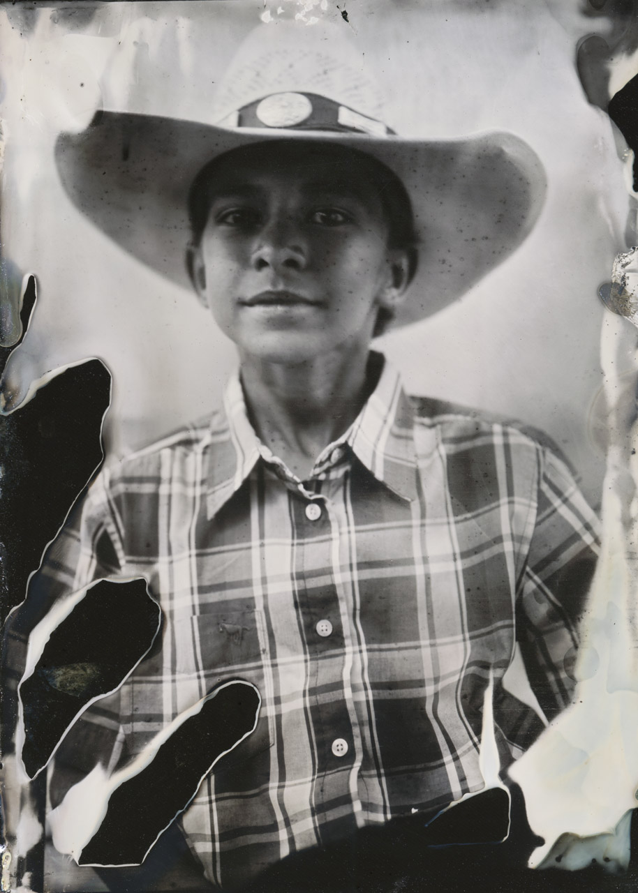 This is Jacob. I met him at the Arcadia Rodeo. He was fascinated with my big old wooden camera. I lowered the tripod and let him look through the ground glass on the back and he was hooked. He immediately wanted to help, so I put him to work and his was the first plate I made that day.