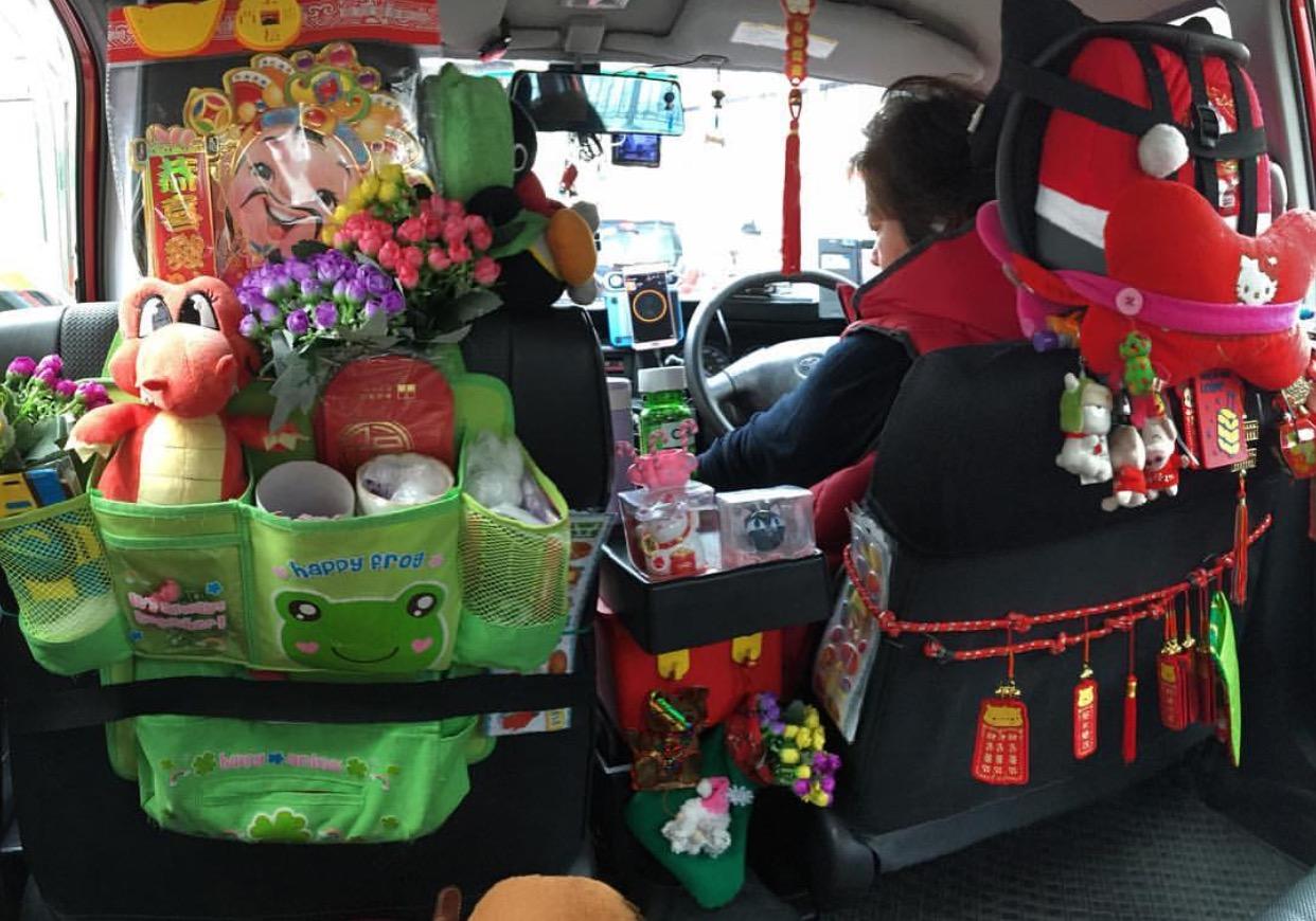 Hong Kong taxi decor can get pretty intense